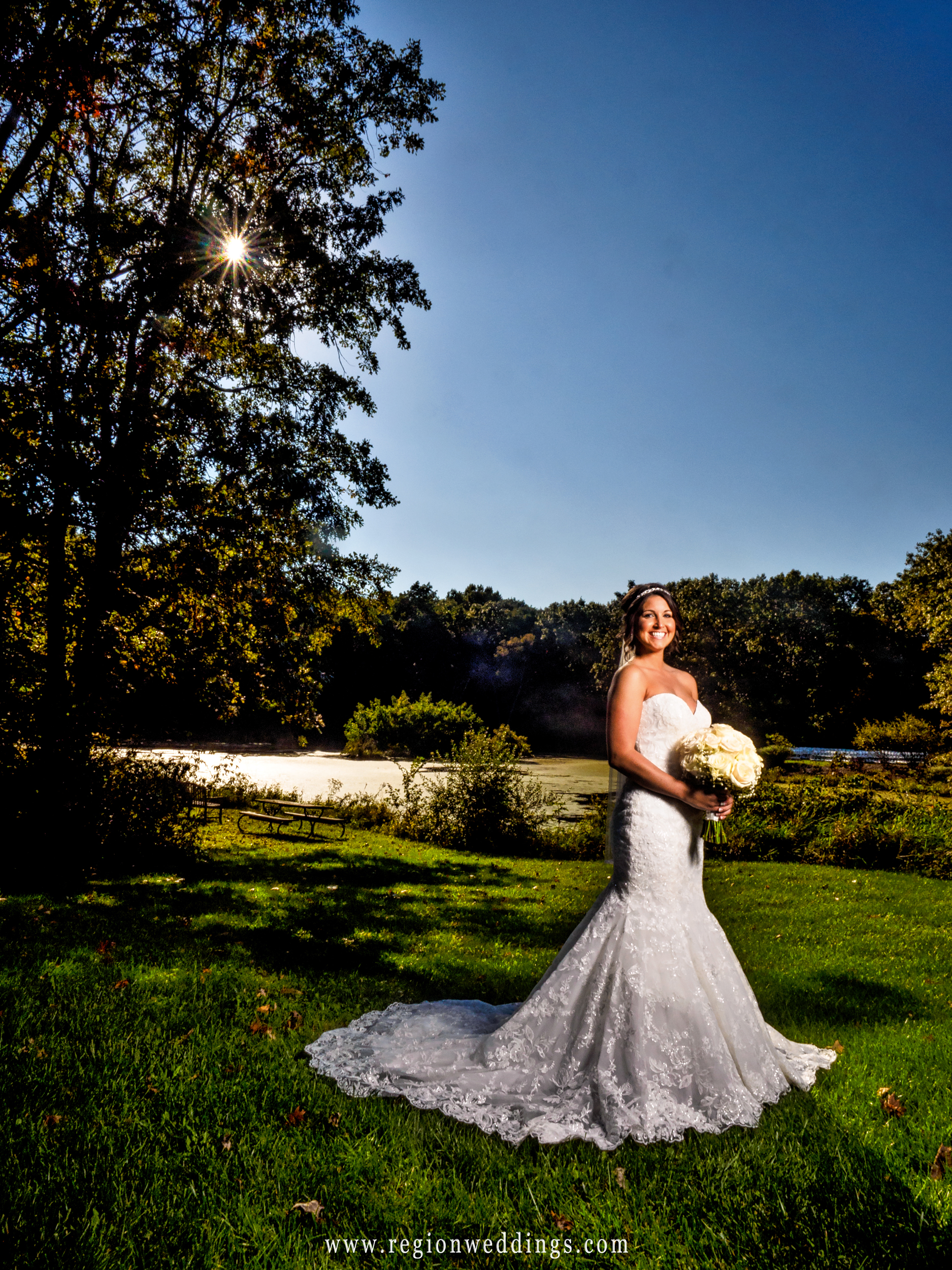 The bride shows off her dress at Taltree Arboretum.