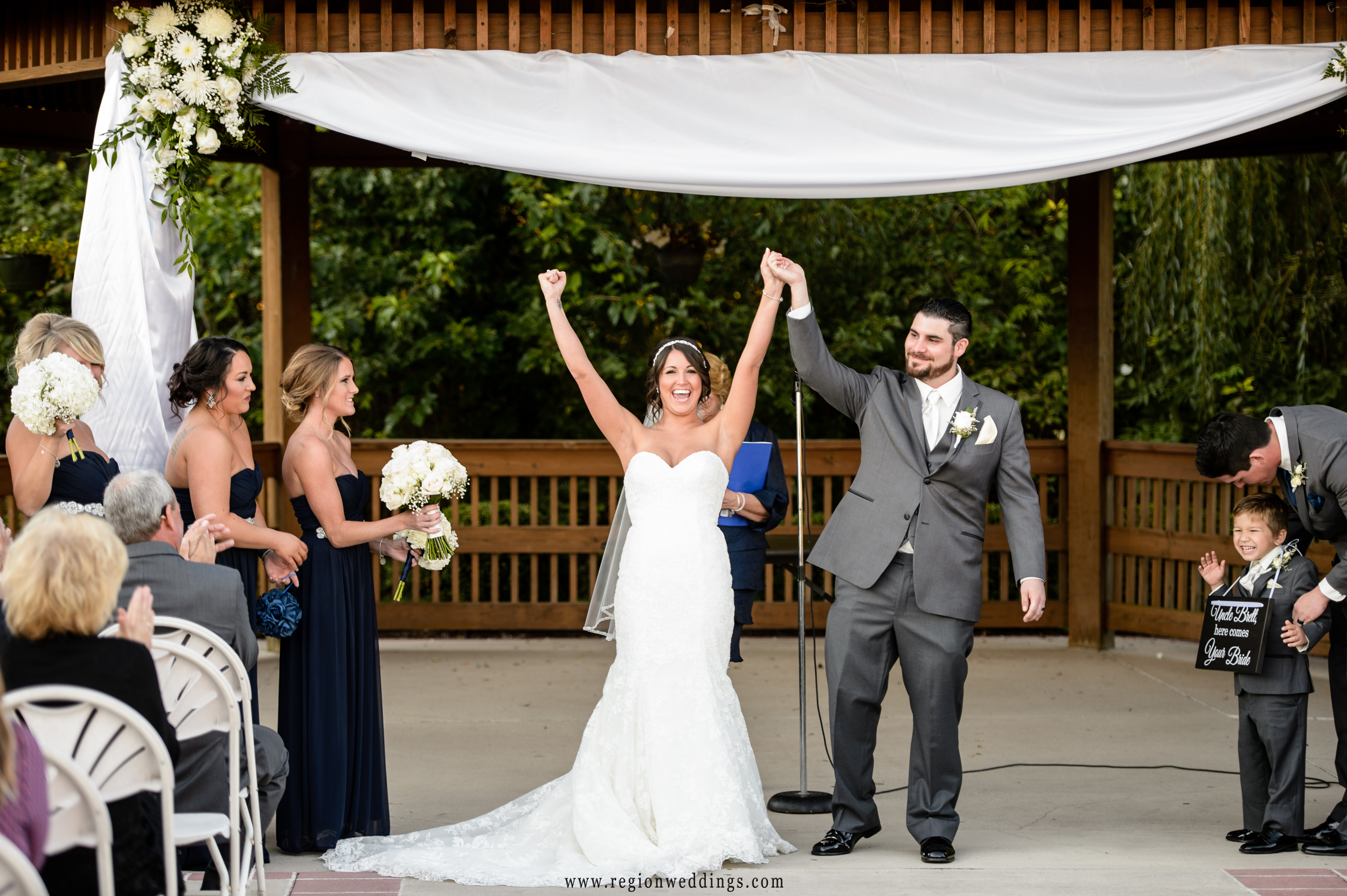 The bride and groom celebrate at their outdoor ceremony at Avalon Manor.