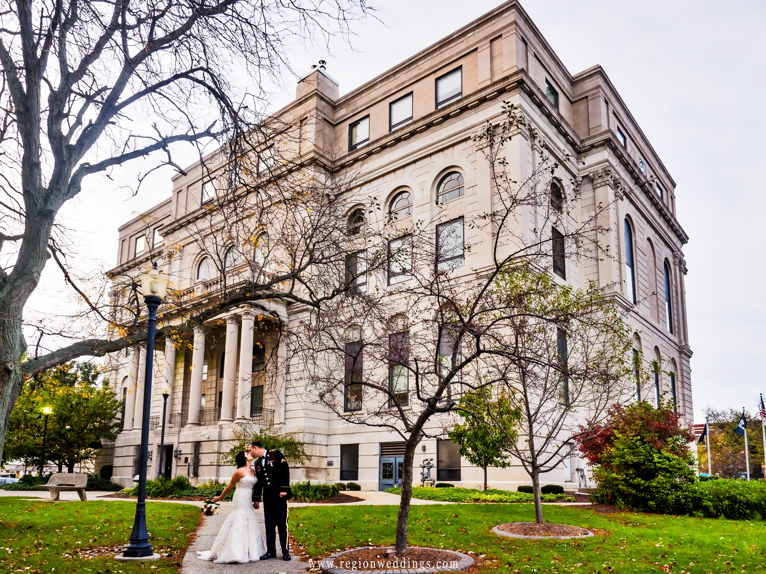 Bride and groom share a kiss outside the Porter County Courthouse in Valparaiso, Indiana.