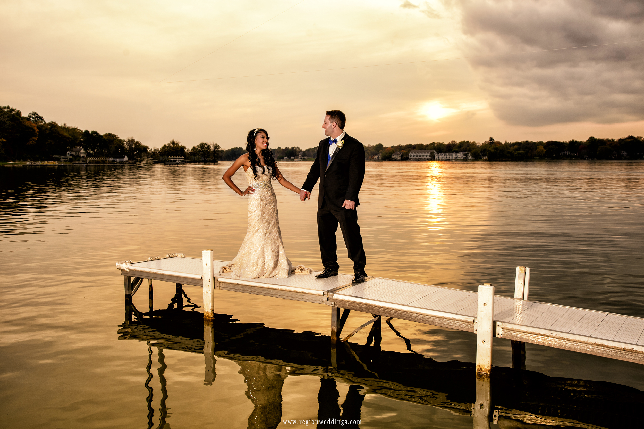 Bride and groom at sunset on the pier at Lighthouse Restaurant in Cedar Lake, Indiana.