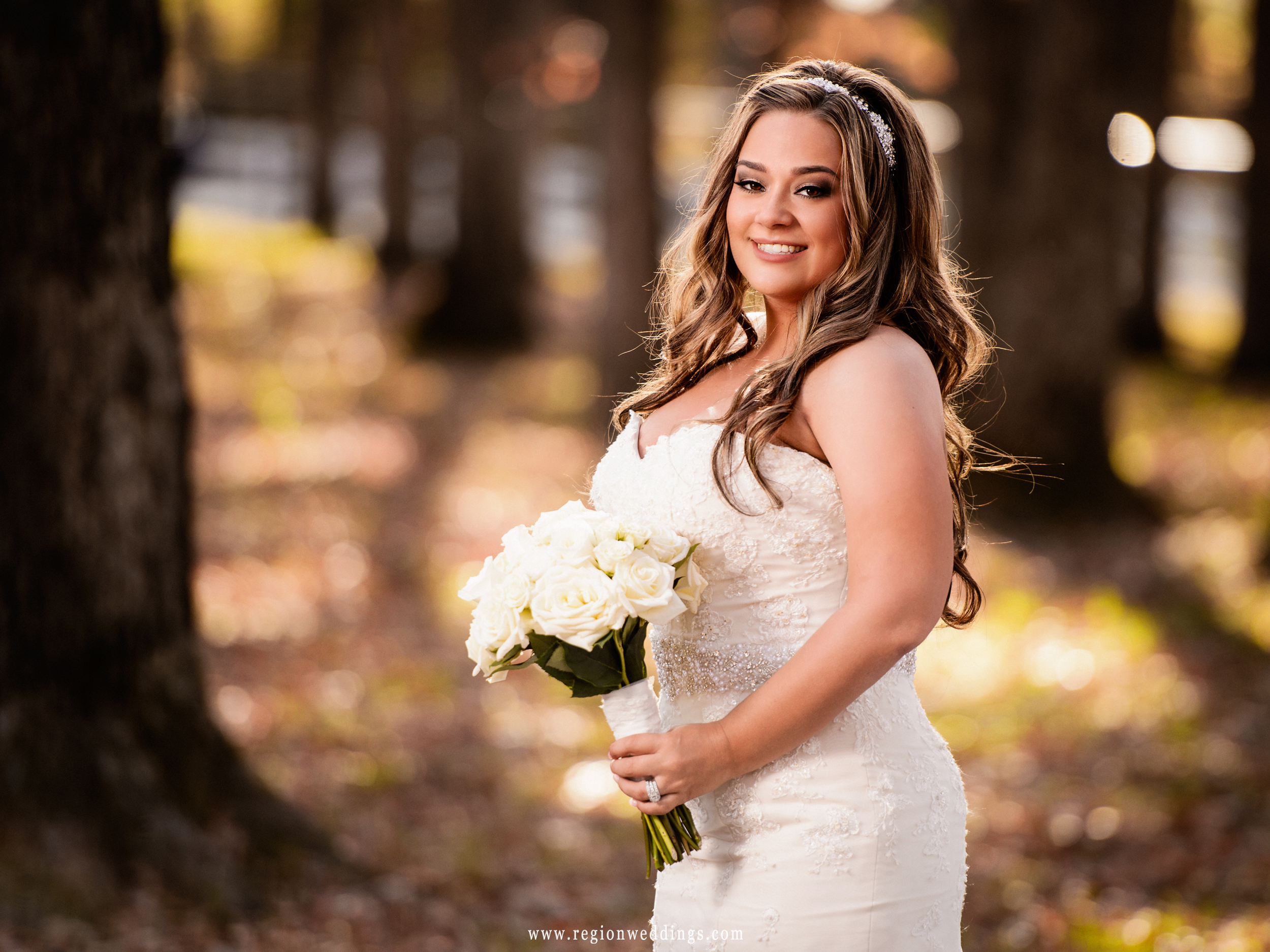 Beautiful bride surrounded by Fall color.