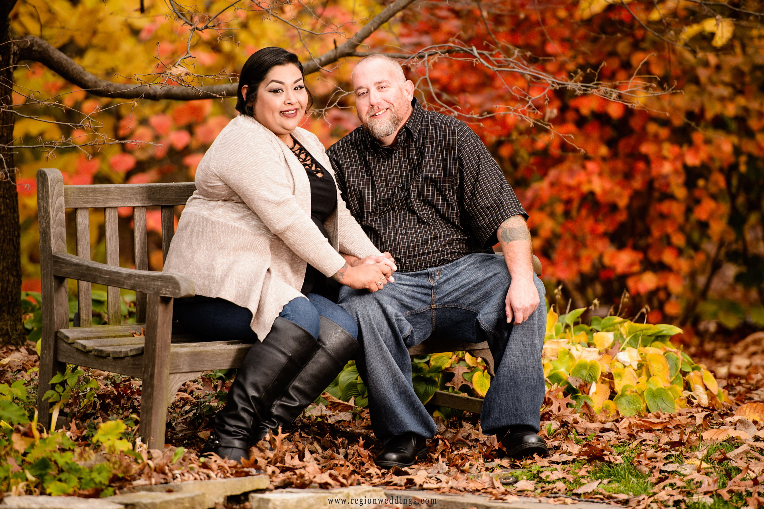 Leaves turn orange and red at Taltree Arboretum for a Fall engagement session.