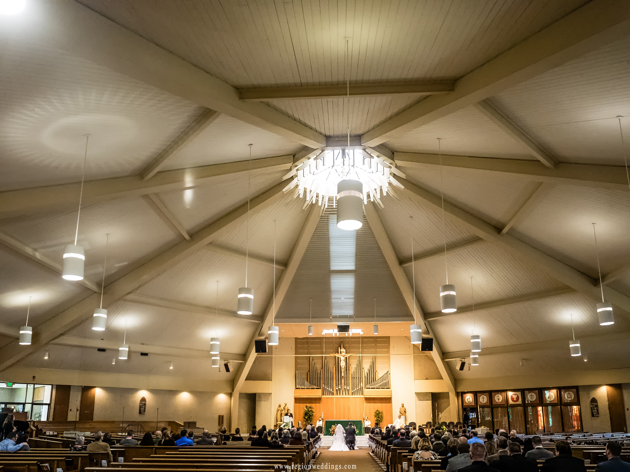 Wedding ceremony at St. Thomas More Church in Munster, Indiana.