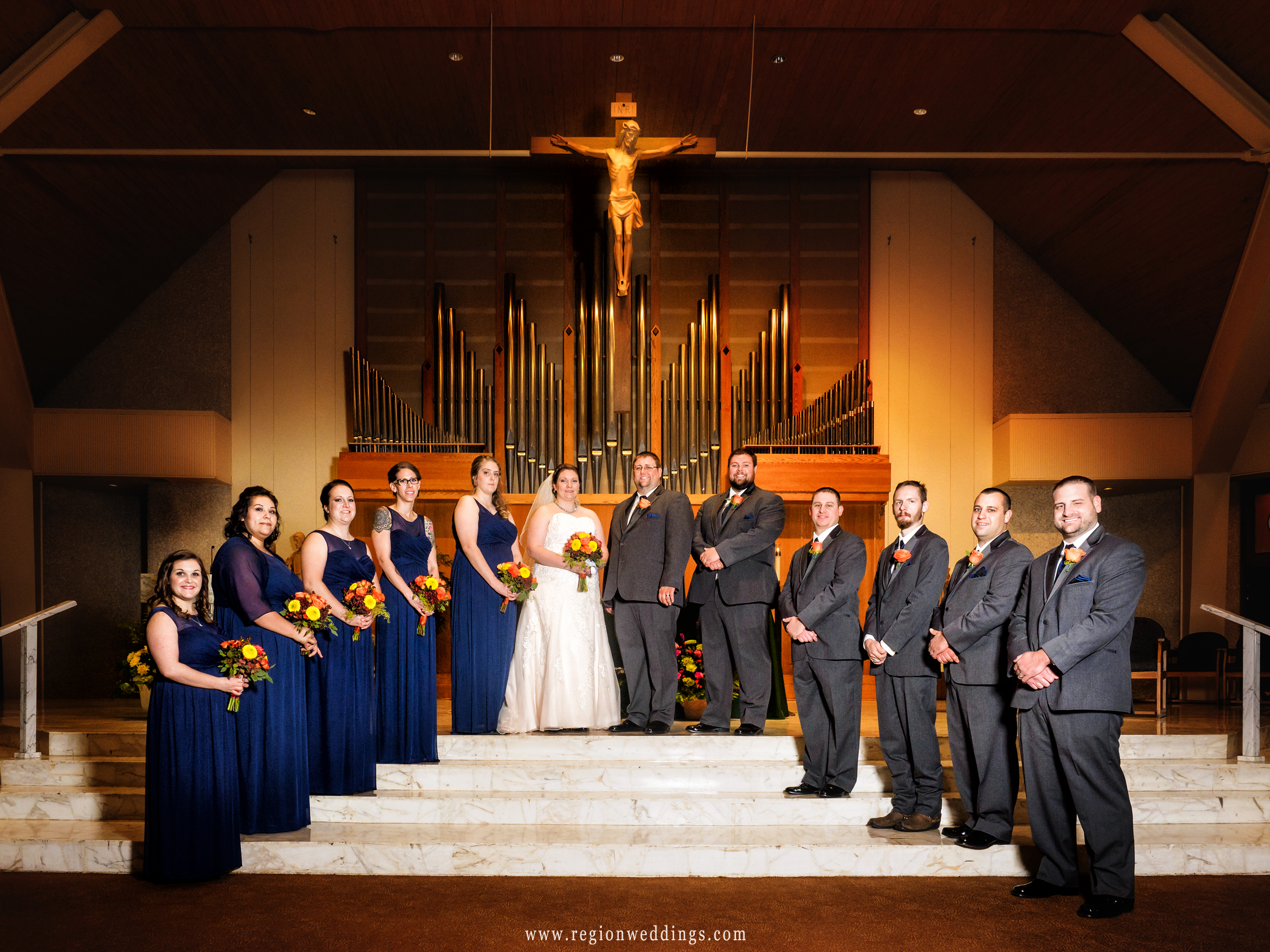 Wedding party on the altar at Saint Thomas More Church in Munster, Indiana.