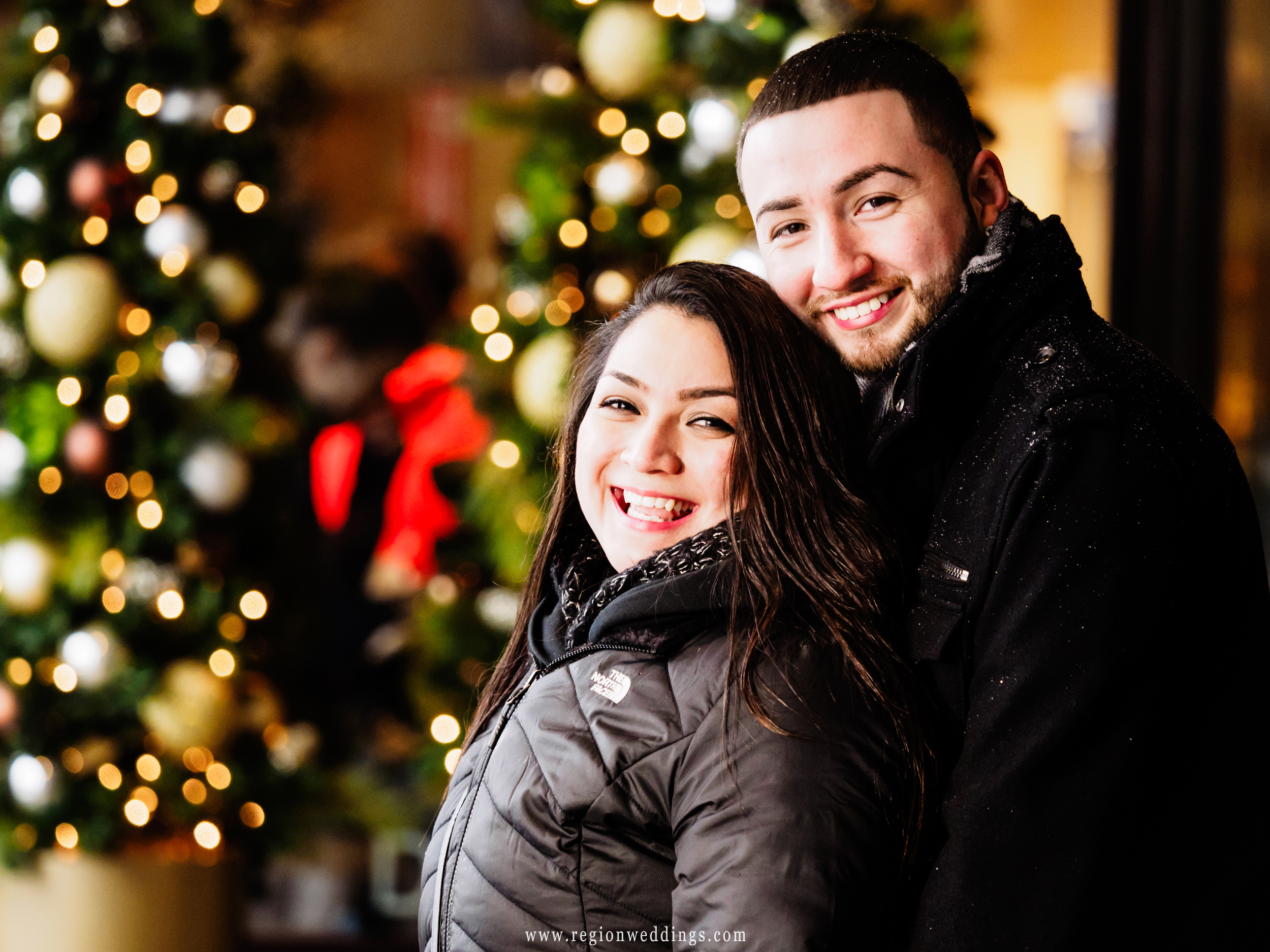 Holiday portrait of the newly engaged couple.
