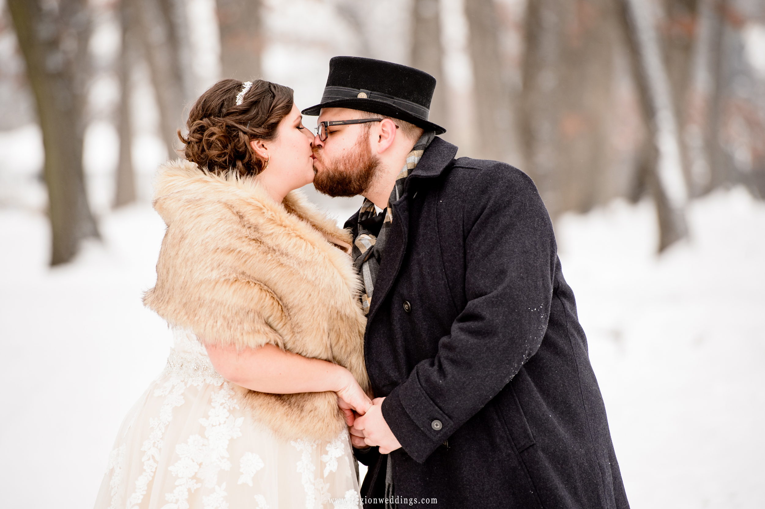 Winter kiss for the bride and groom.