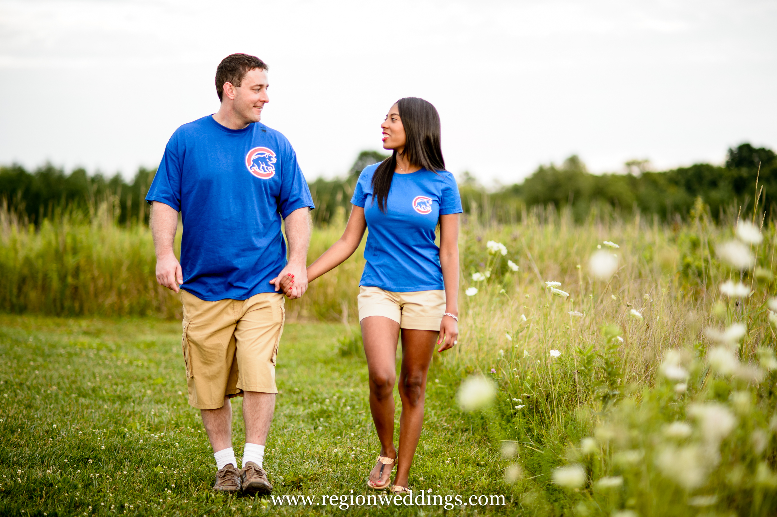 Two Chicago Cubs fans take a stroll at Taltree Arboretum.