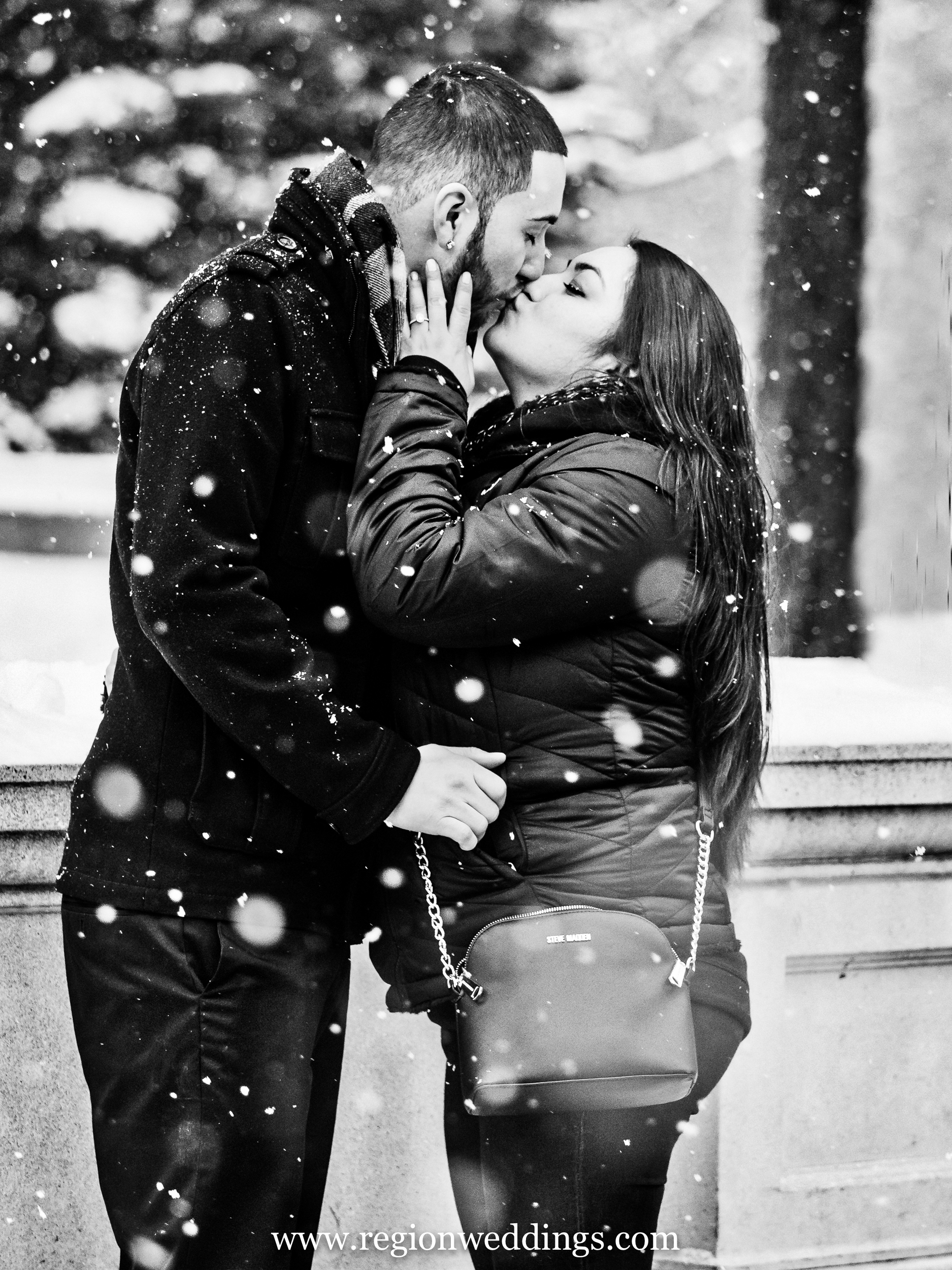 Winter kiss during a snowstorm in Chicago.