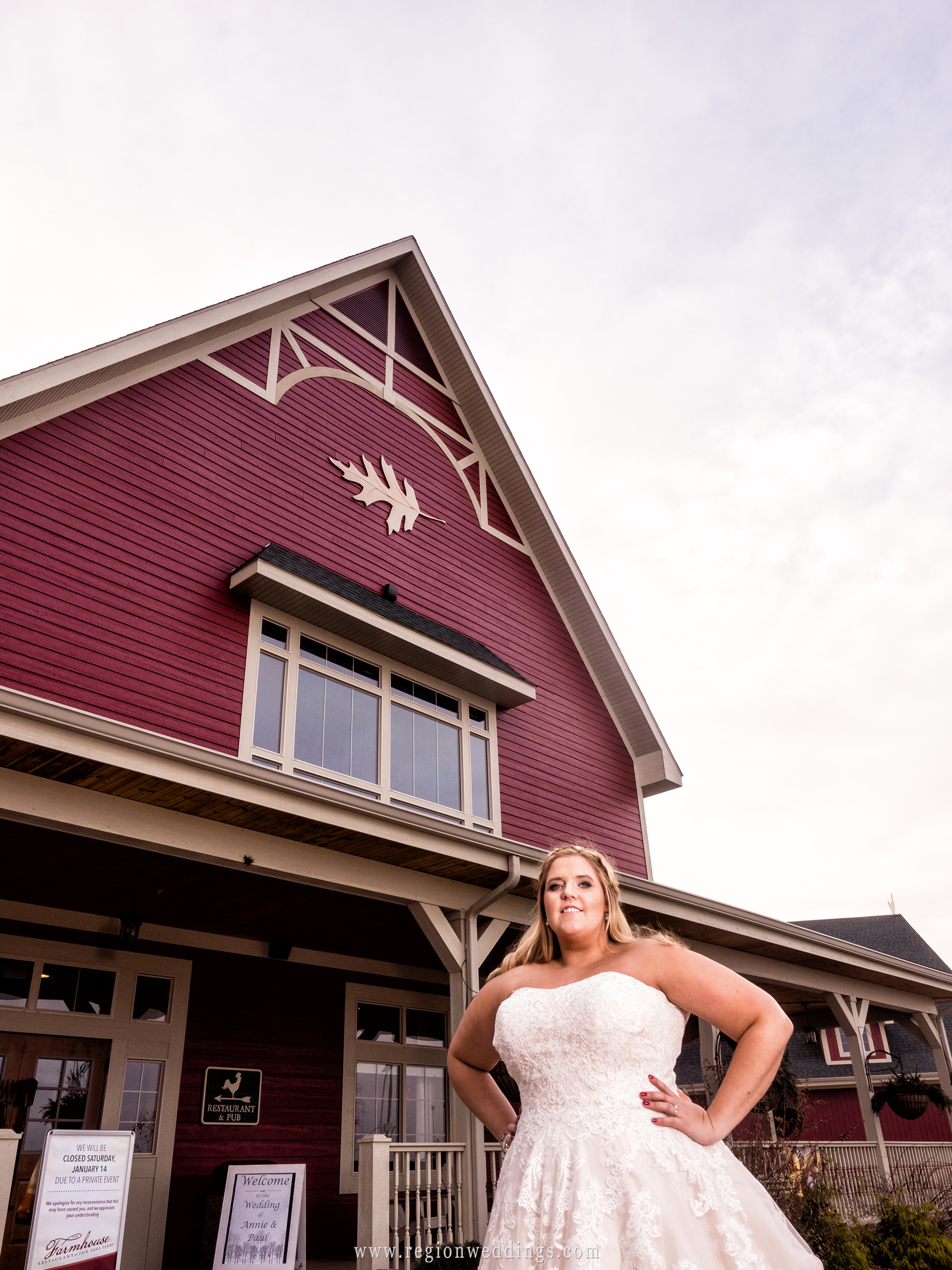 The bride in front of Fair Oaks Farmhouse at her winter wedding.
