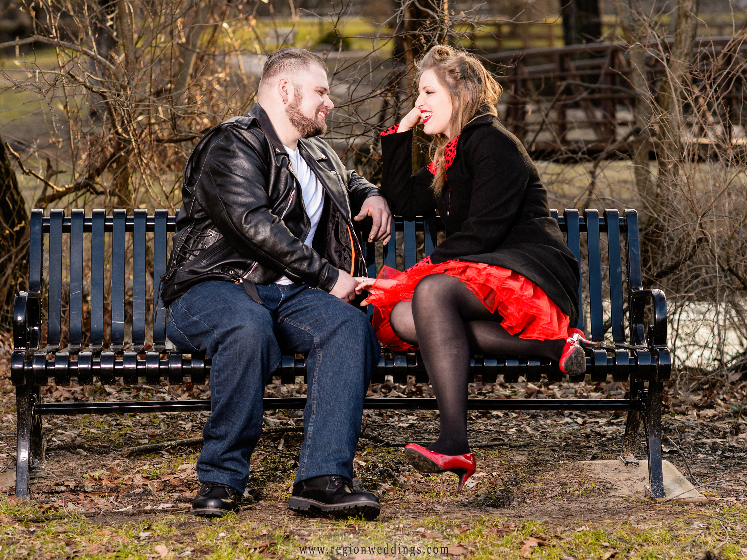 A fun moment on a park bench during a winter engagement session.