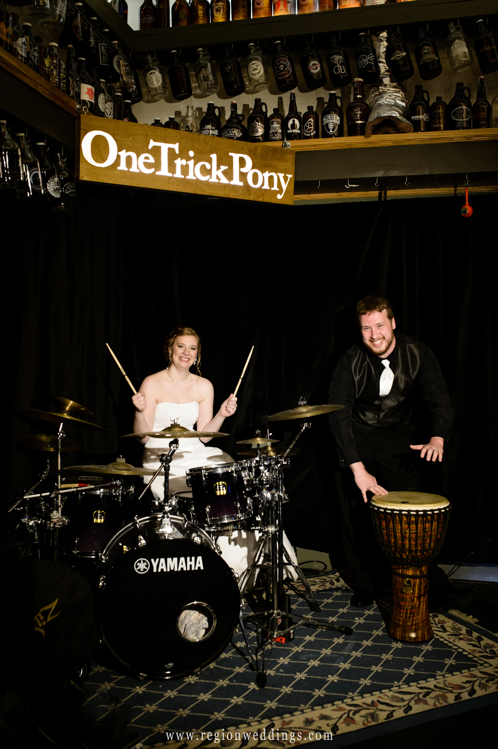 Bride and groom behind the drum kit at One Trick Pony brewery.