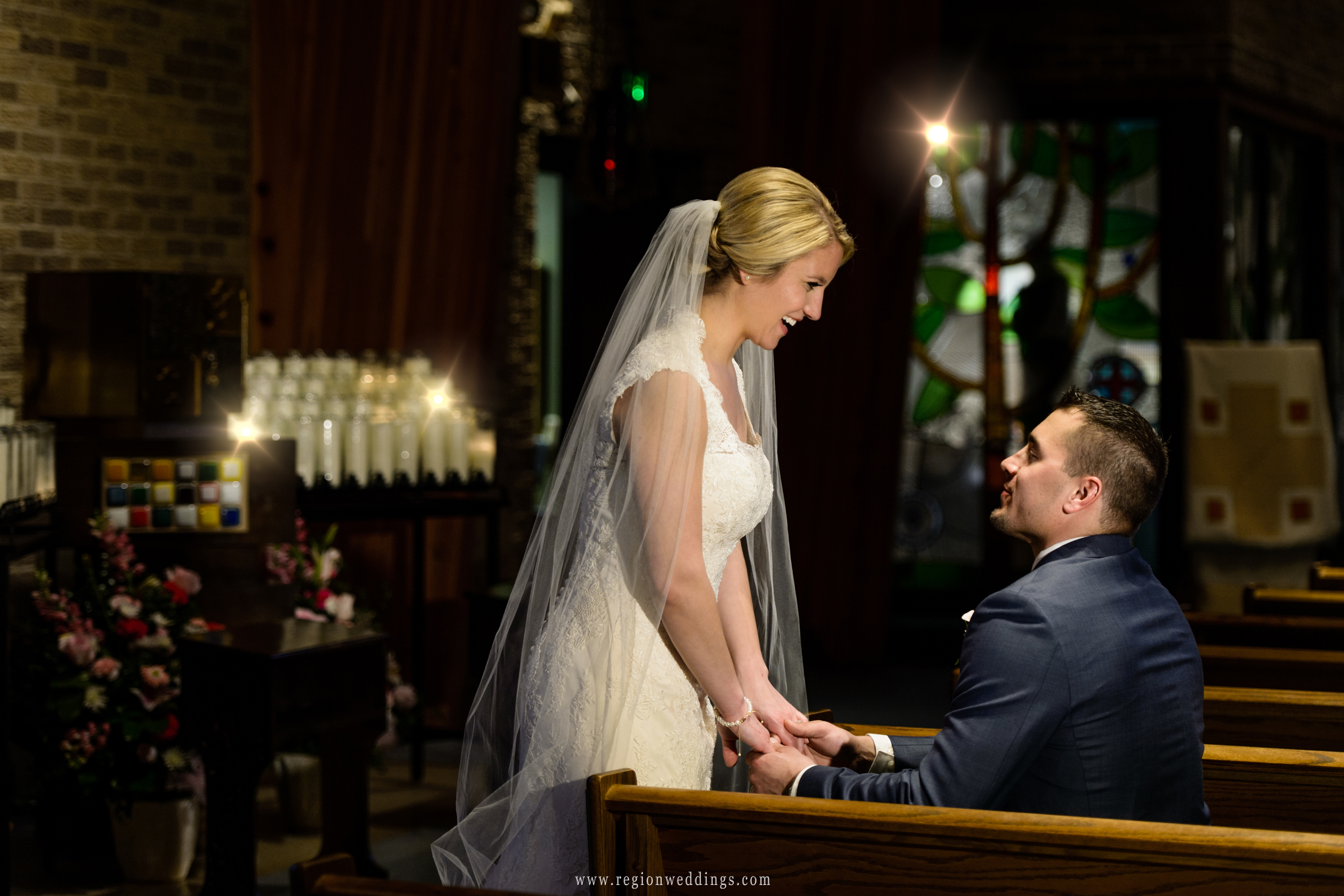The bride and groom share a moment at St. Maria Goretti Church.