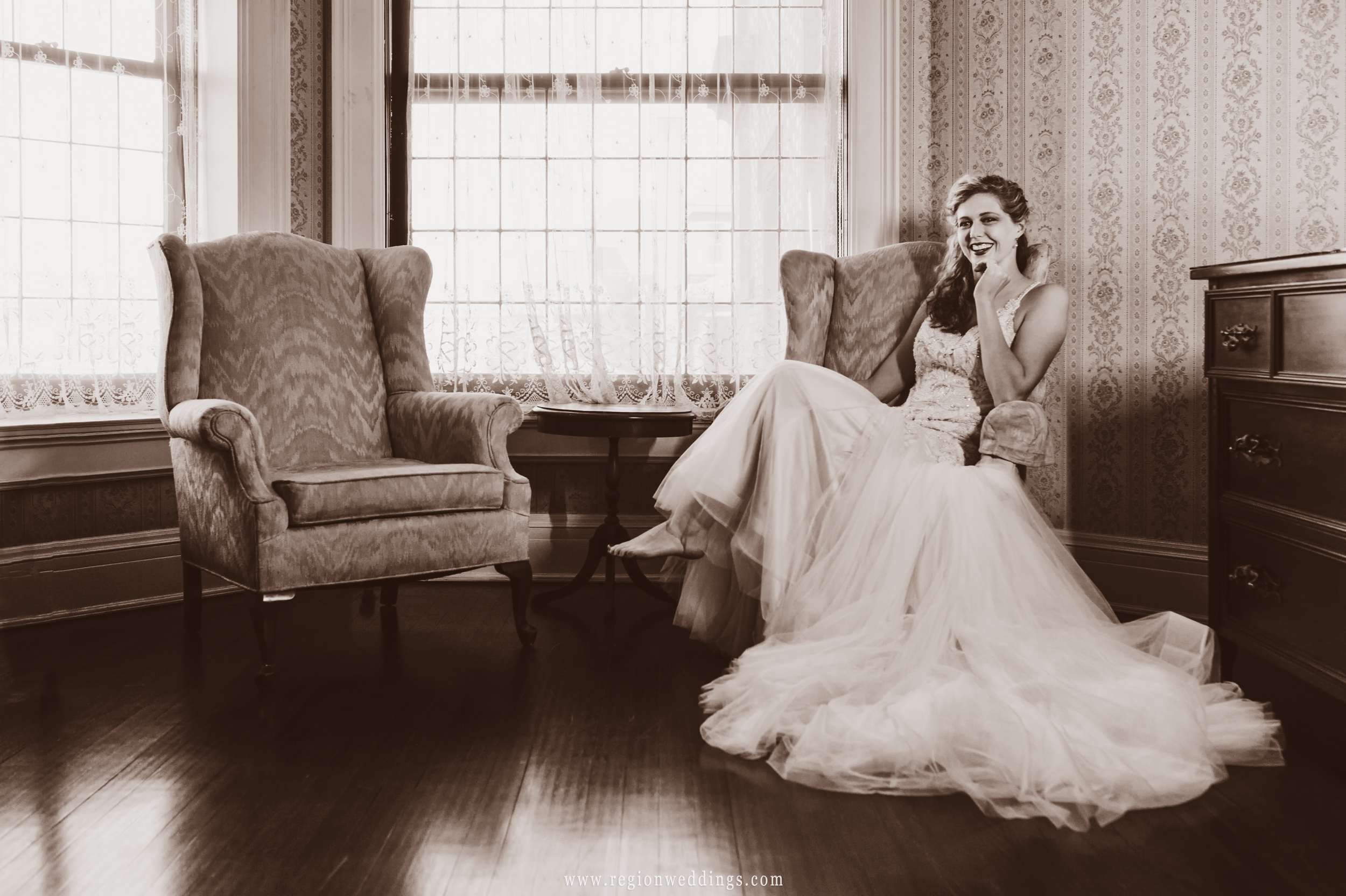Barefoot and laughing inside the bridal suite at Barker Mansion.