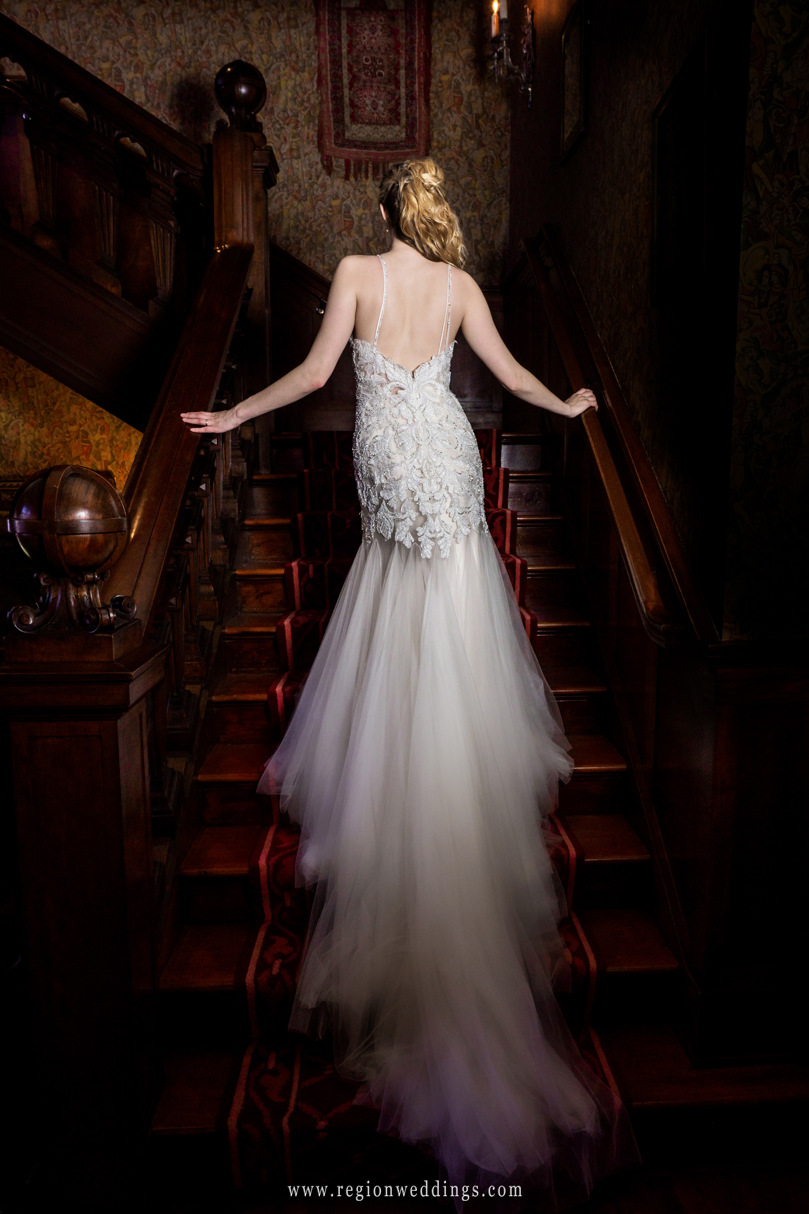 Showing off the dress on the red carpeted staircase.