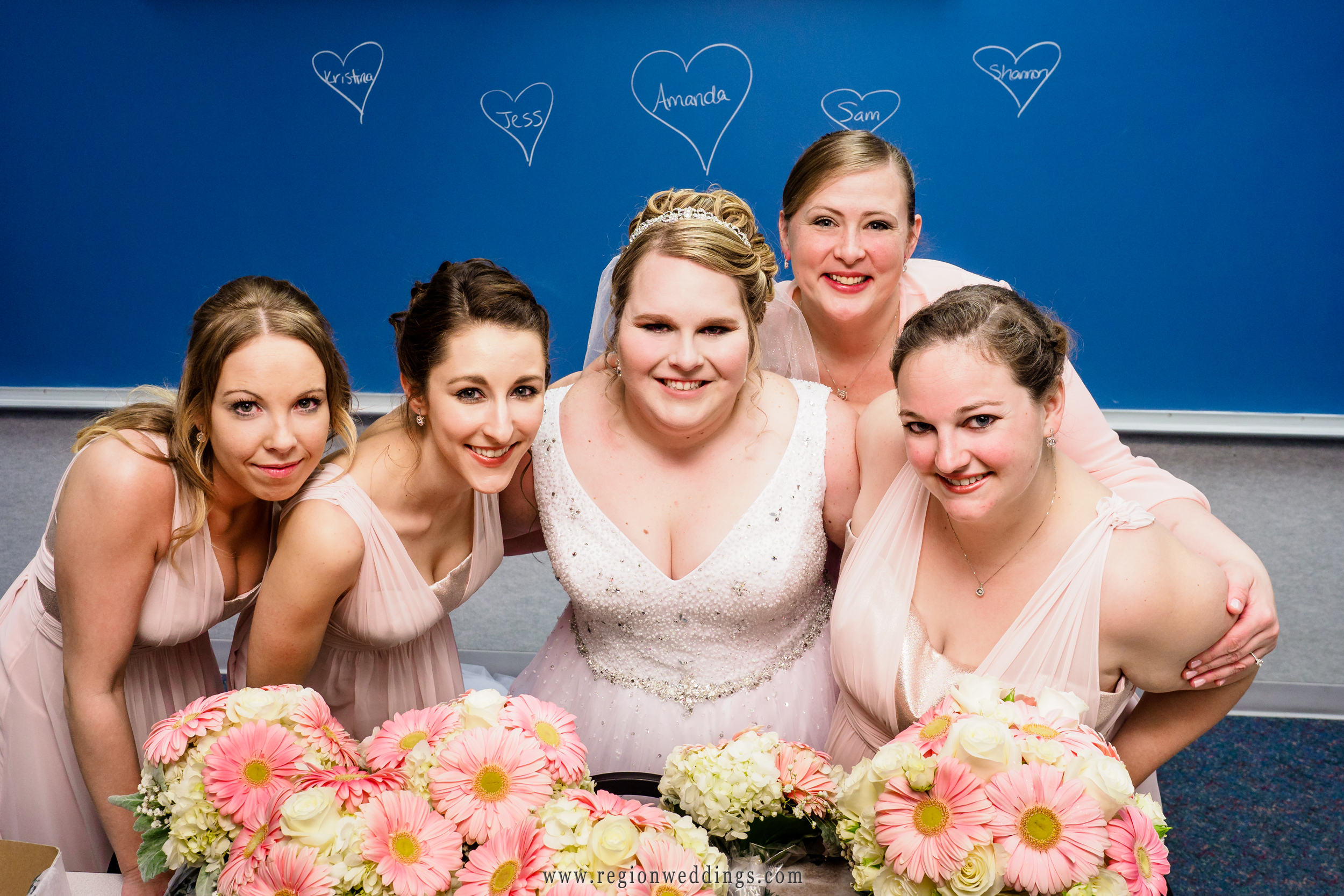 Fun bridesmaids photo with hearts on a chalkboard.