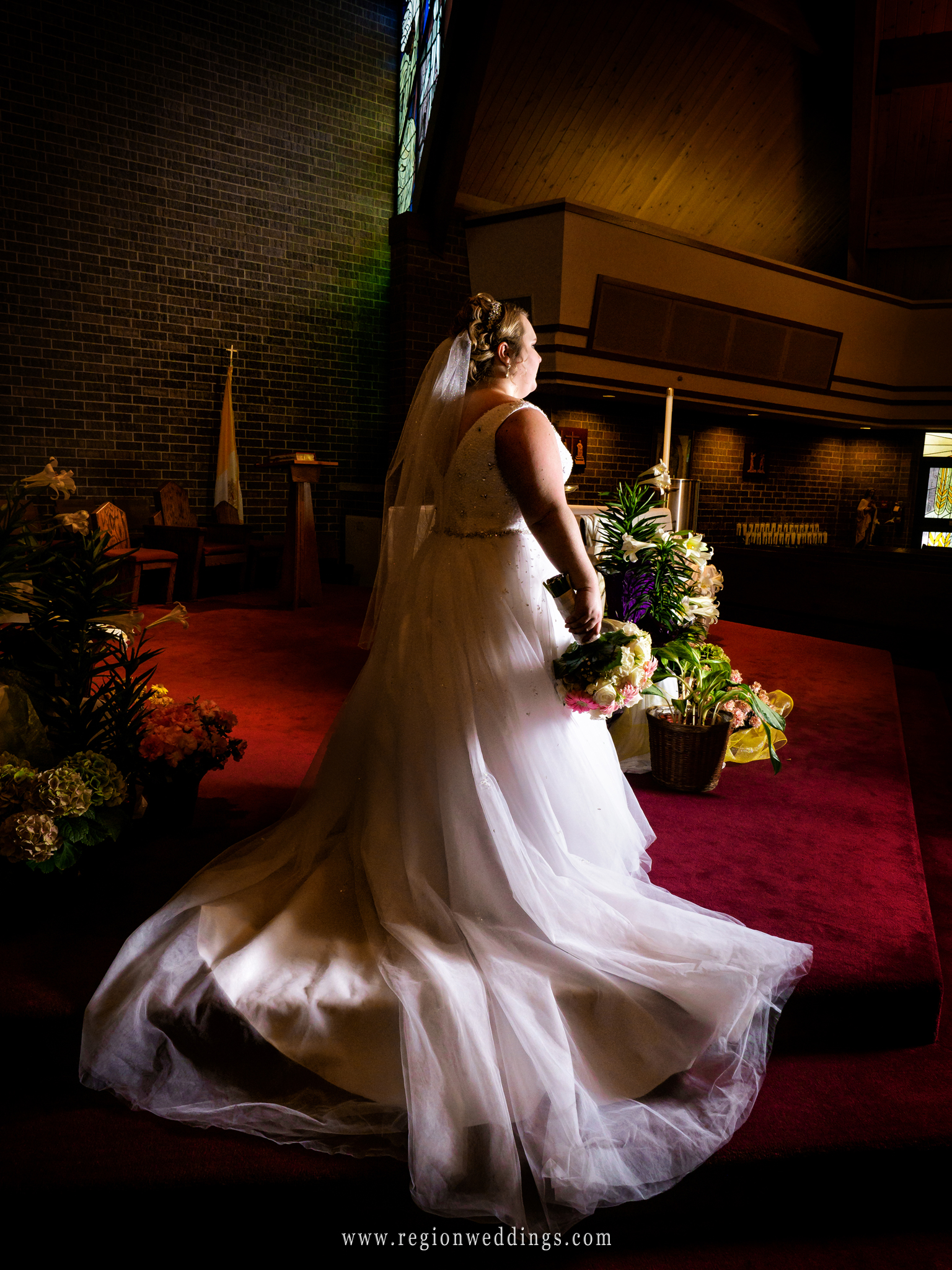 Beautiful bride on the altar at St. James the Less Catholic Church.
