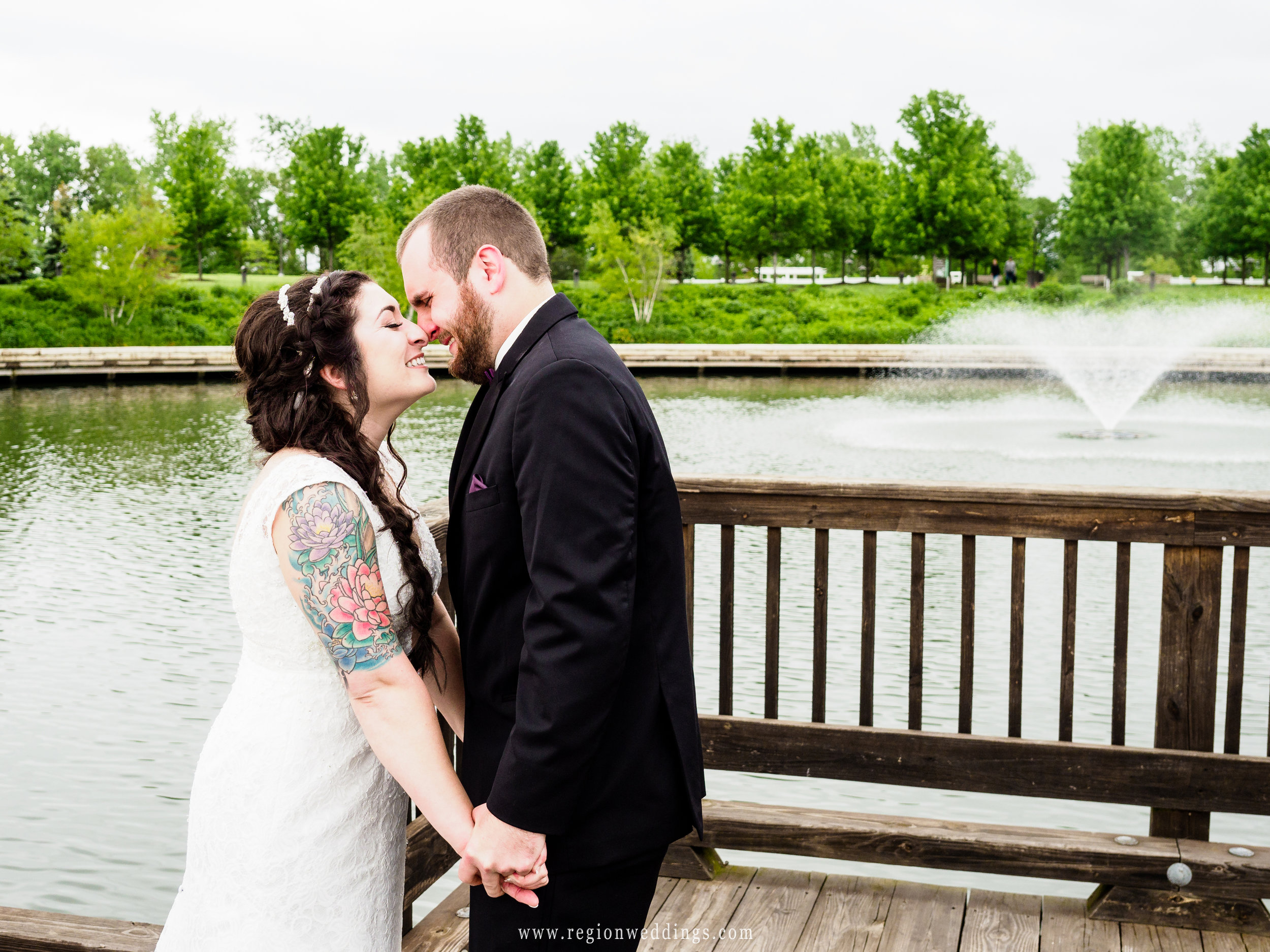 Bride and groom eskimo kiss during their first look.