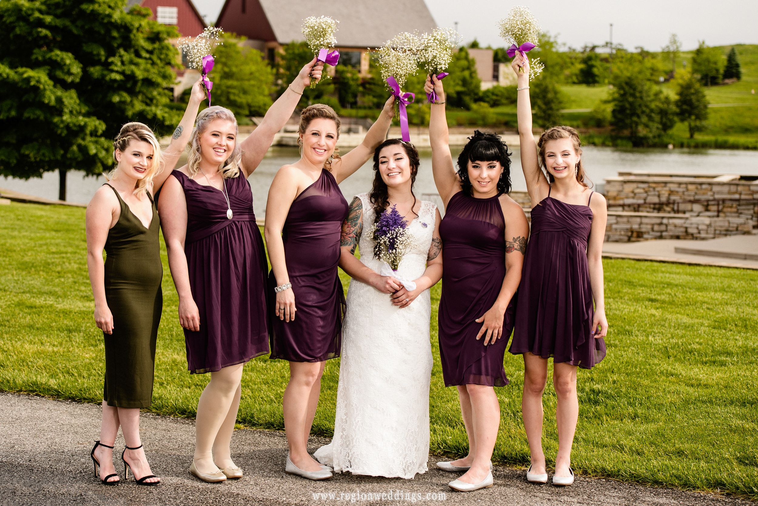 The bridesmaids cheer on the bride.