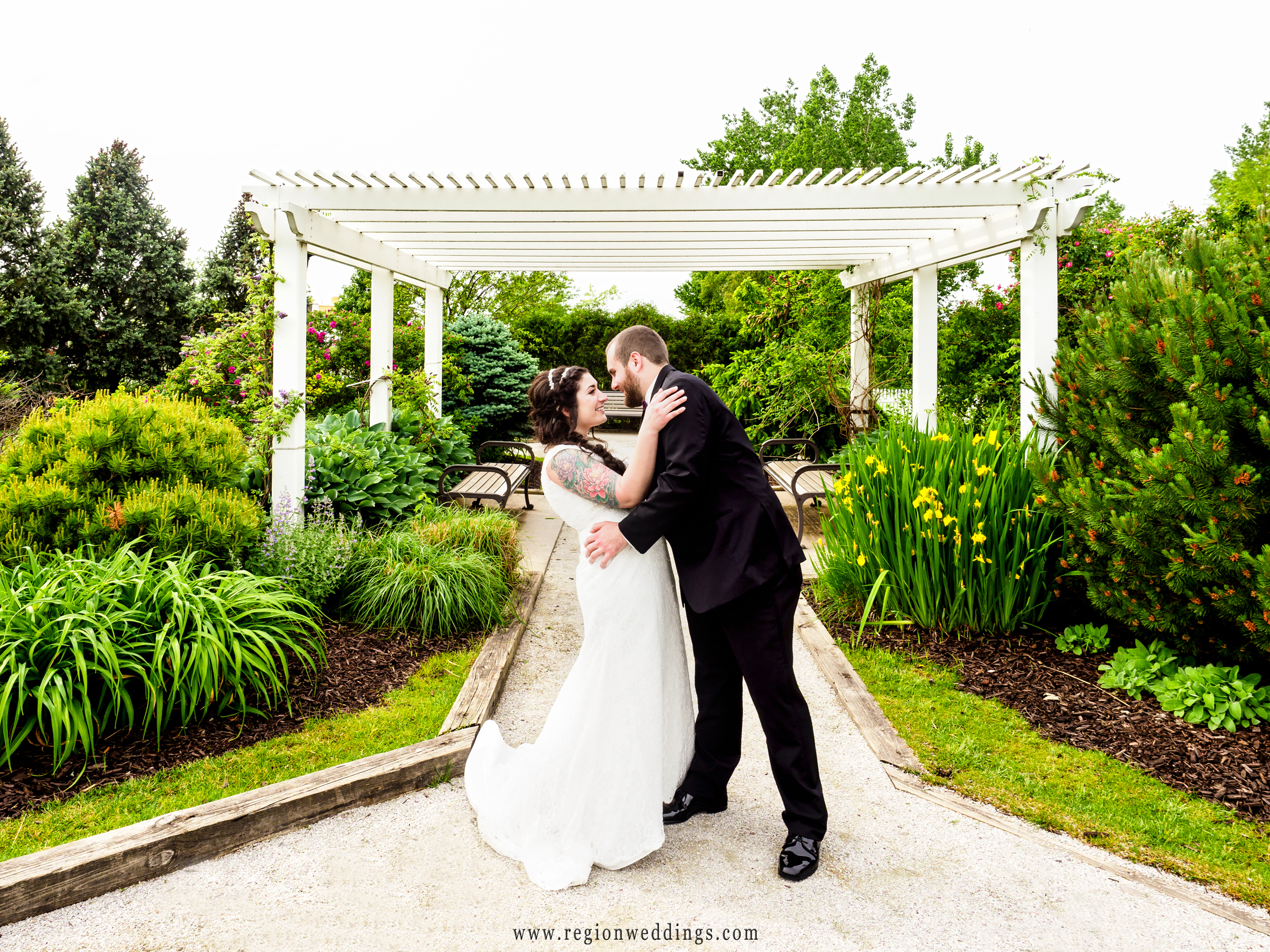 Bride and groom in the colorful garden at Centennial Park.