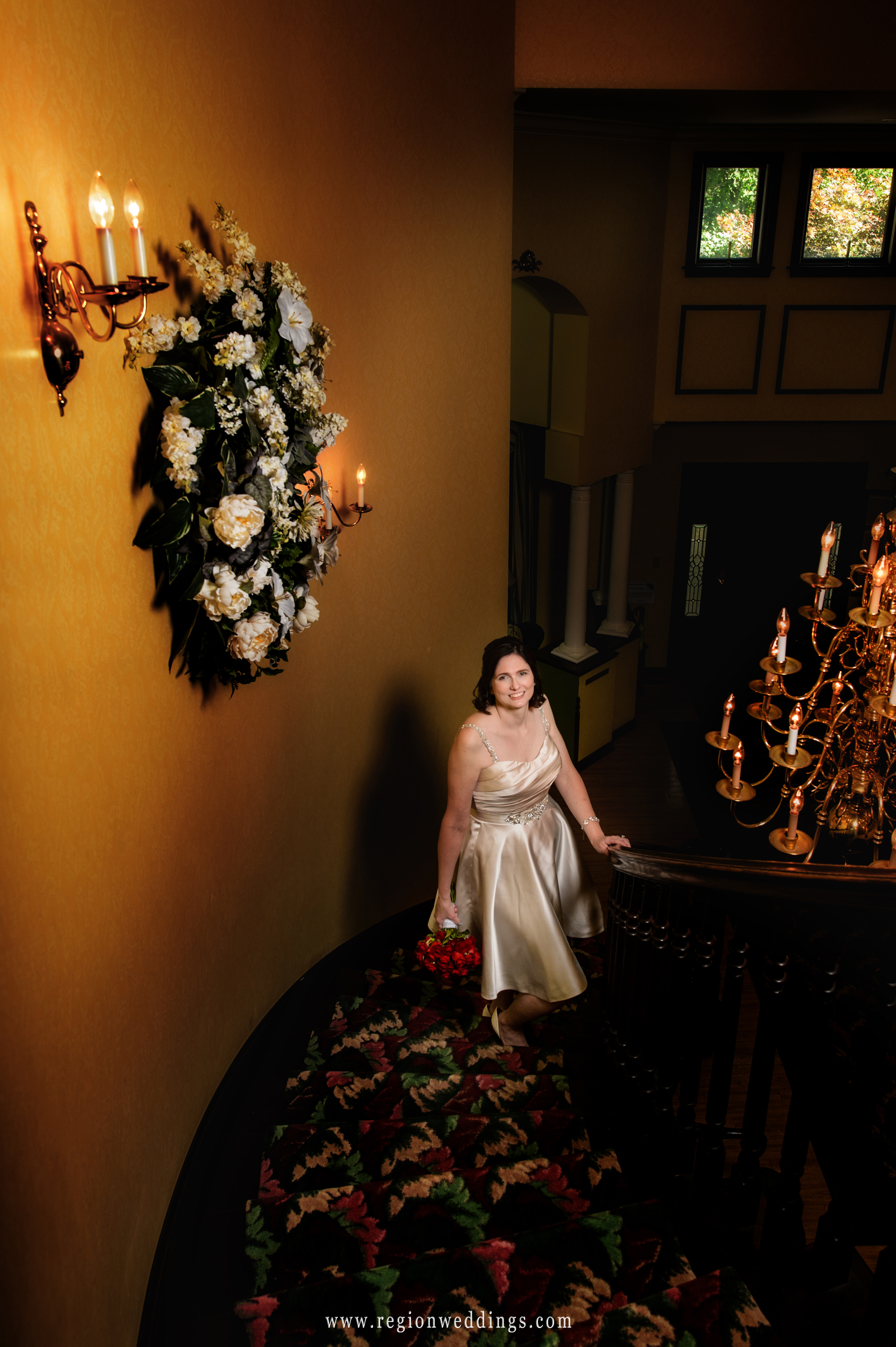 Bride on the staircase at The Inn At Aberdeen in Valparaiso, Indiana.