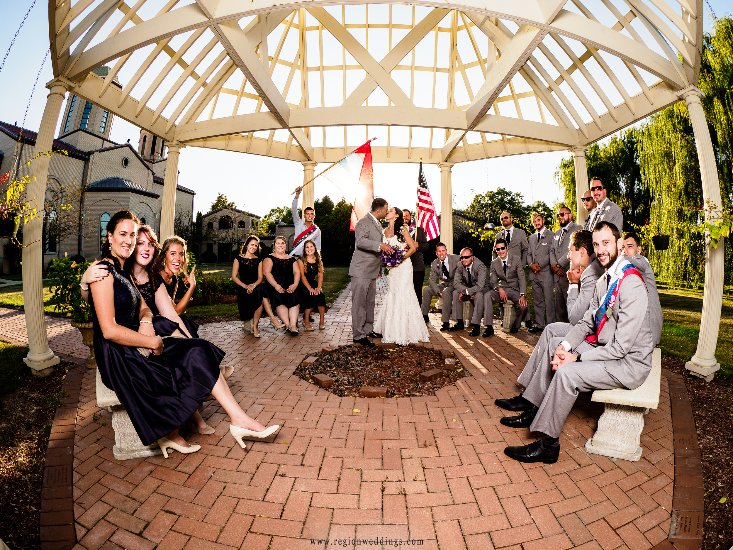 A fun wedding party photo under the gazebo at Serbian Social Center in Lansing, Illinois.
