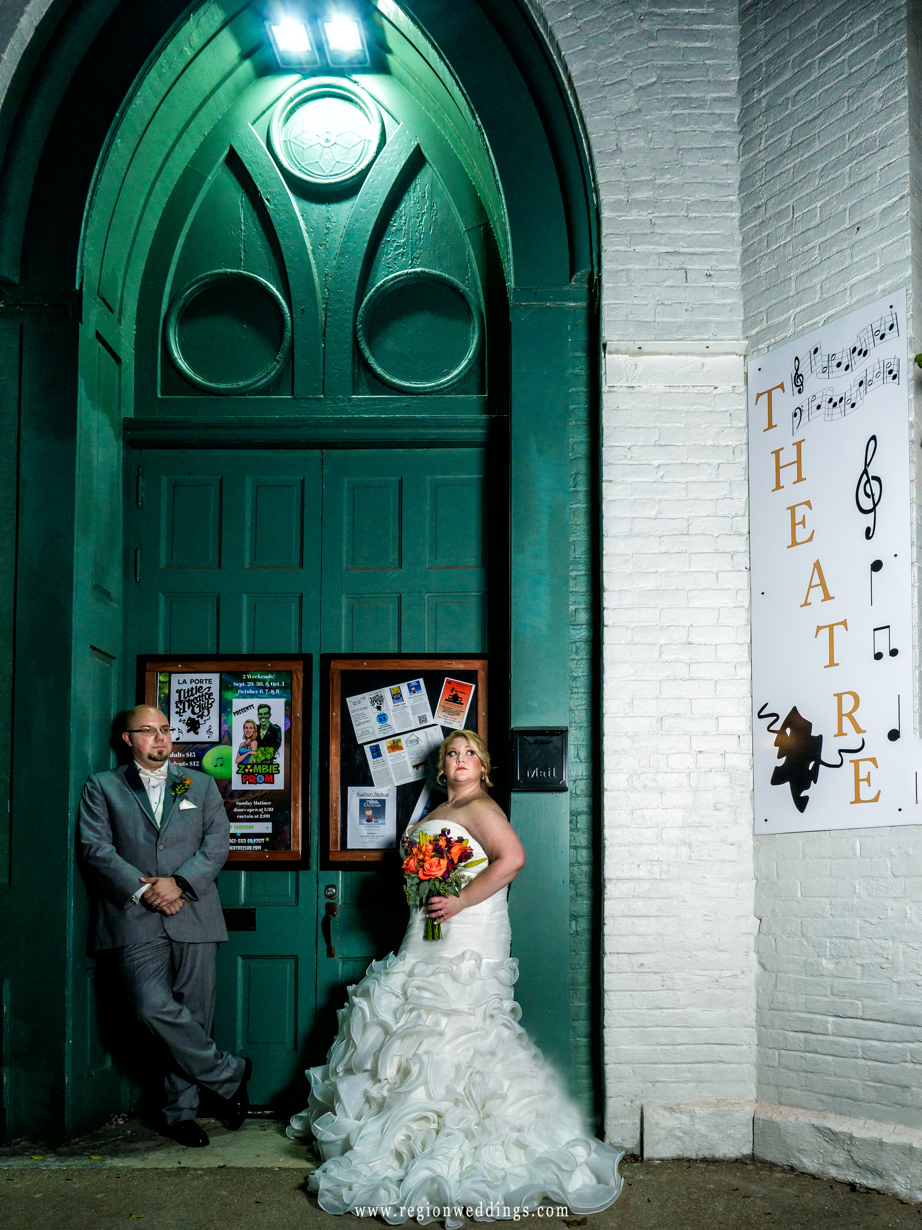 Bride and groom looking rad in front of The Laporte Little Theatre Club.