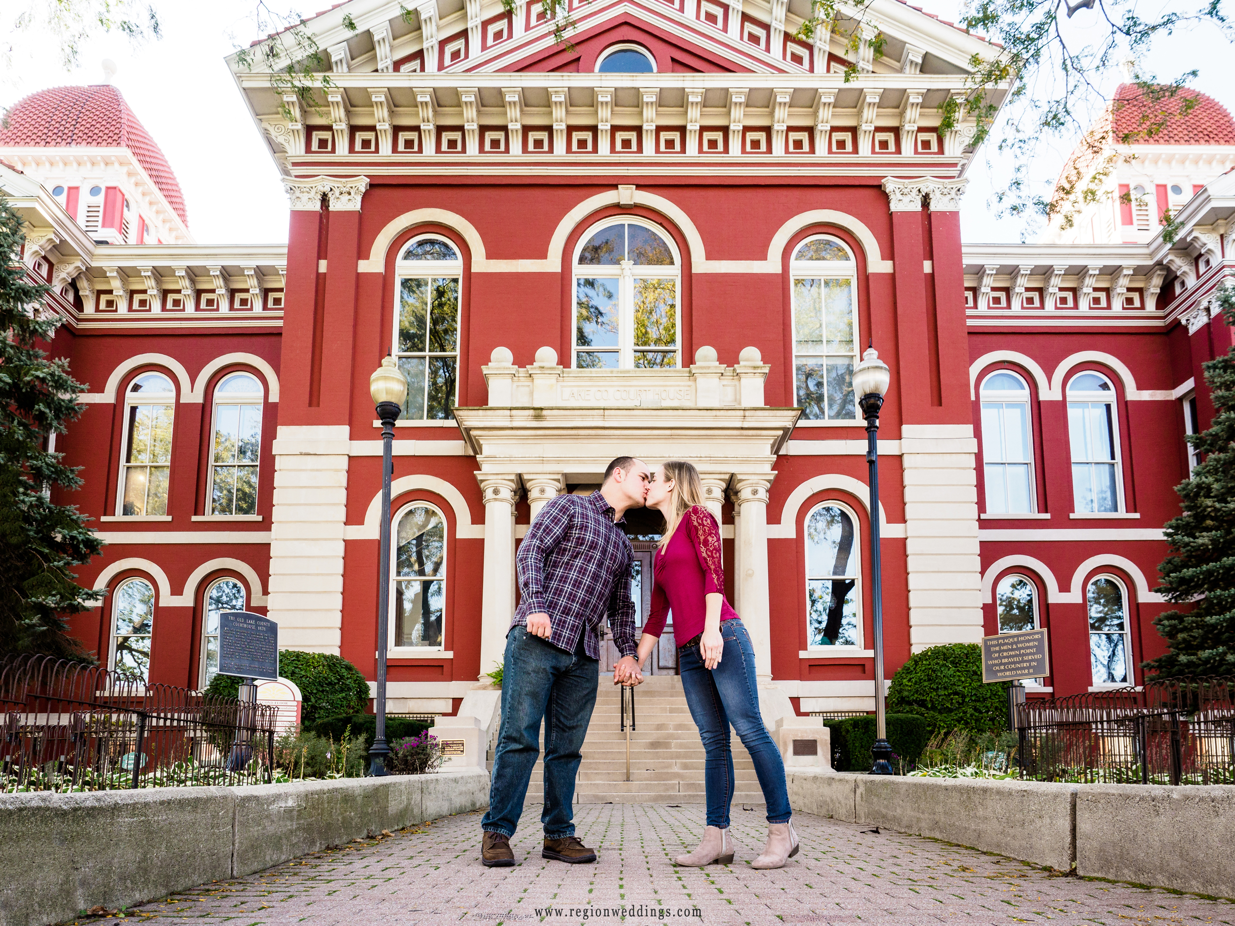 A couple in love in front of the old Crown Point Courthouse.