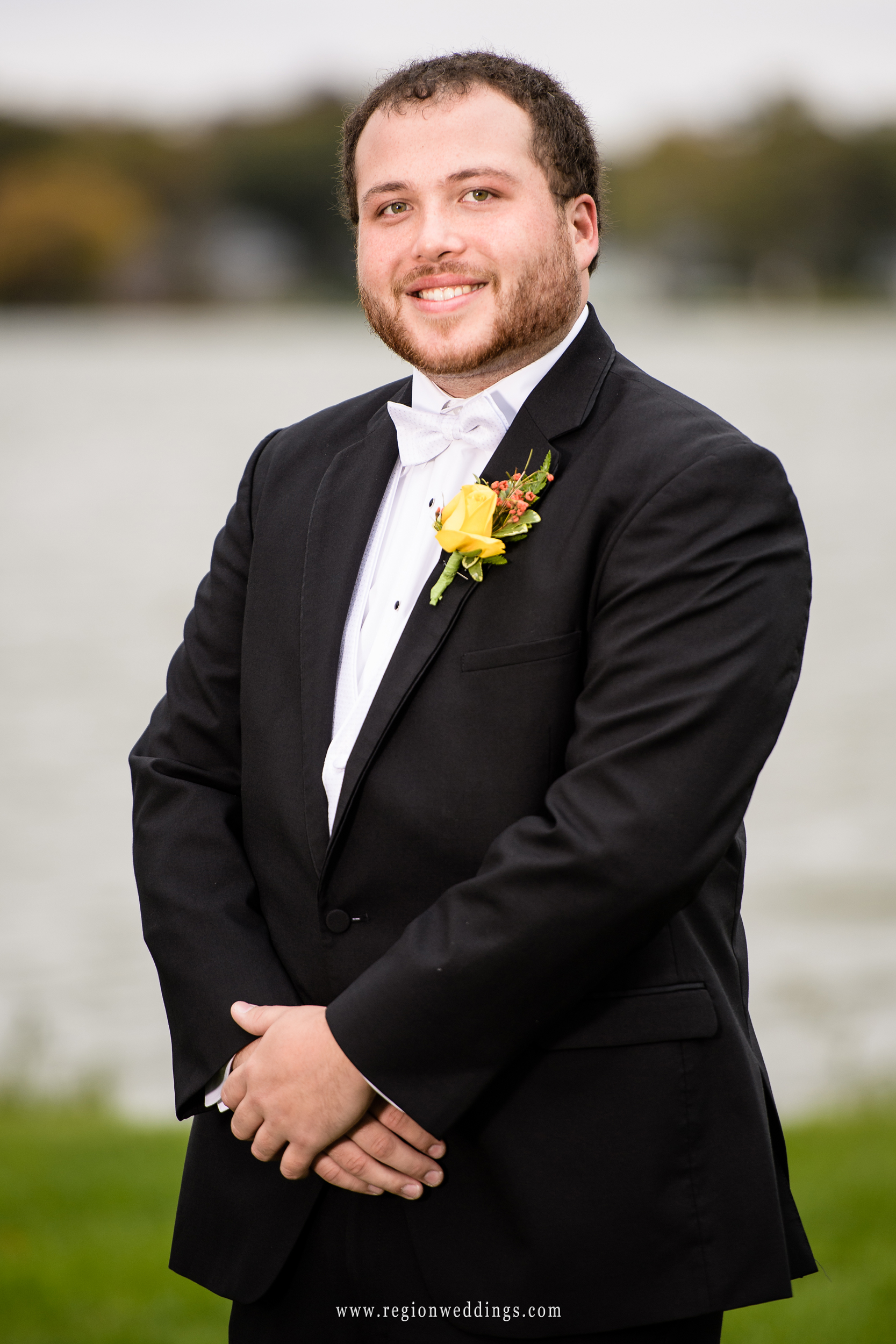 The groom at his Fall wedding at Lighthouse Restaurant.