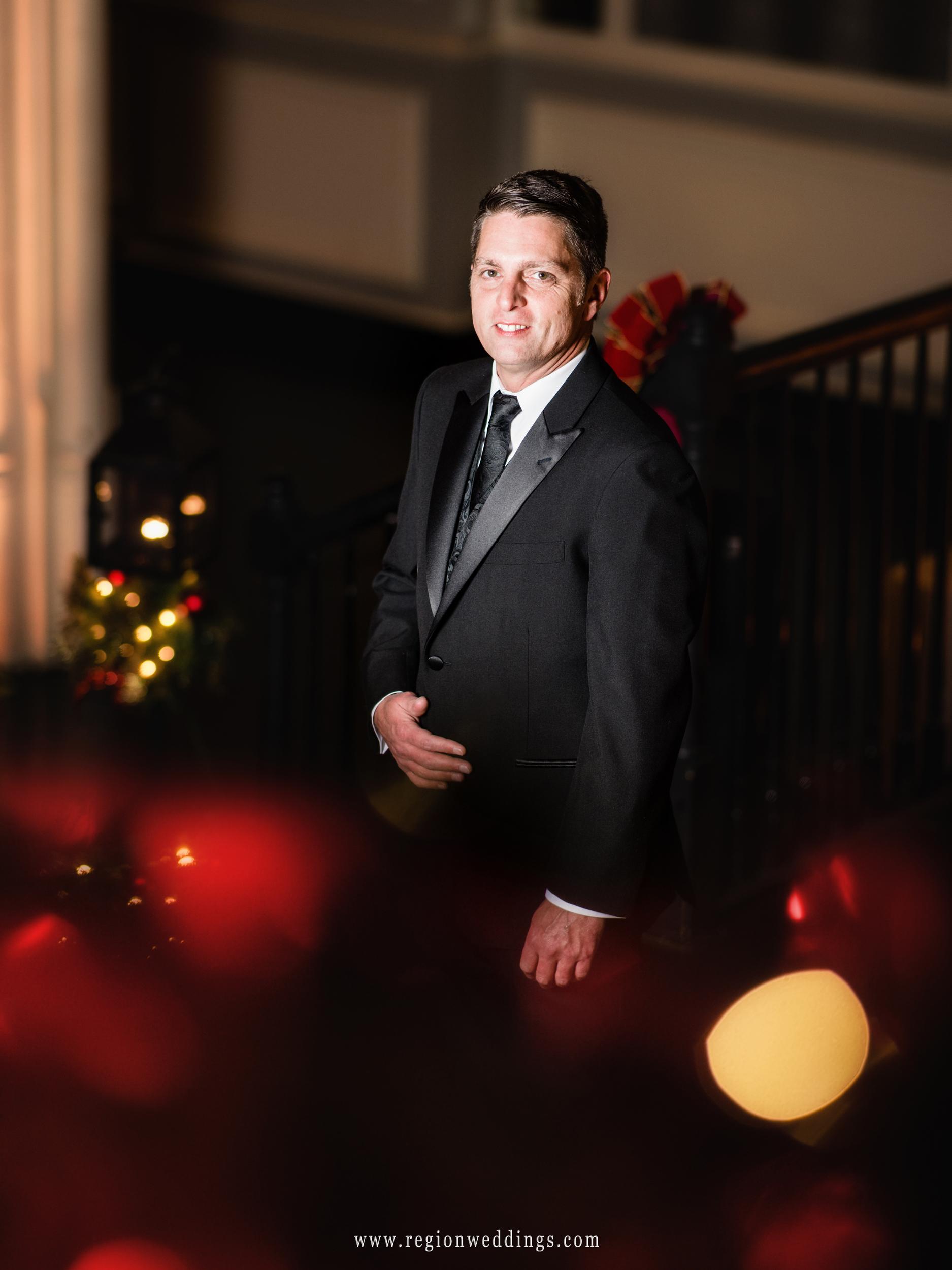 The groom strikes a GQ pose at his Christmas wedding.
