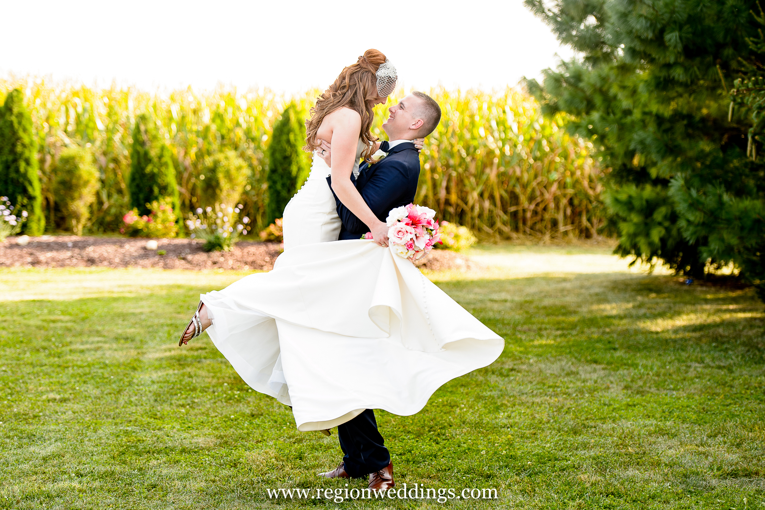 The groom spins his bride near the cornfields of Indiana.