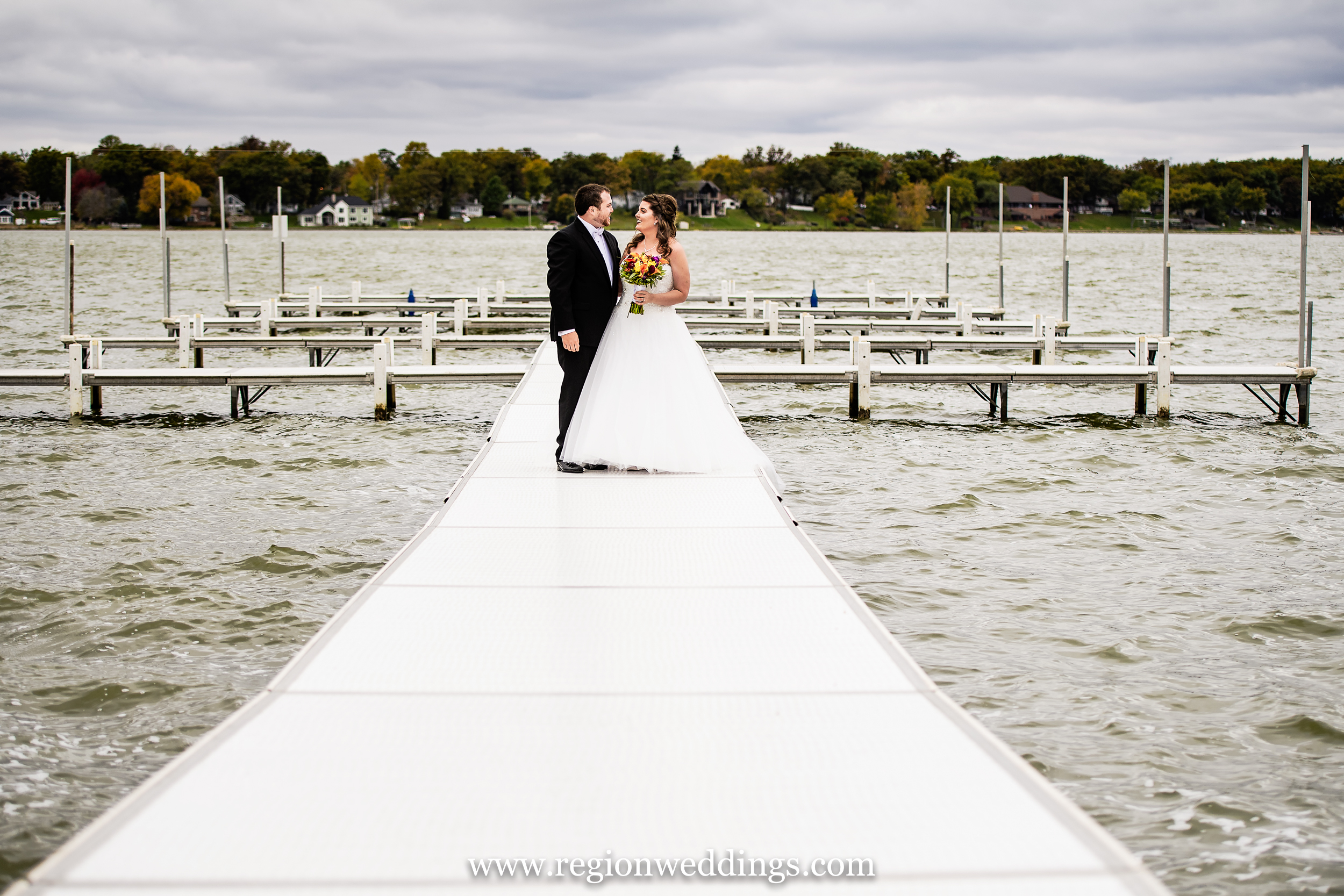 Bride and groom on the pier at Lighthouse Restaurant.