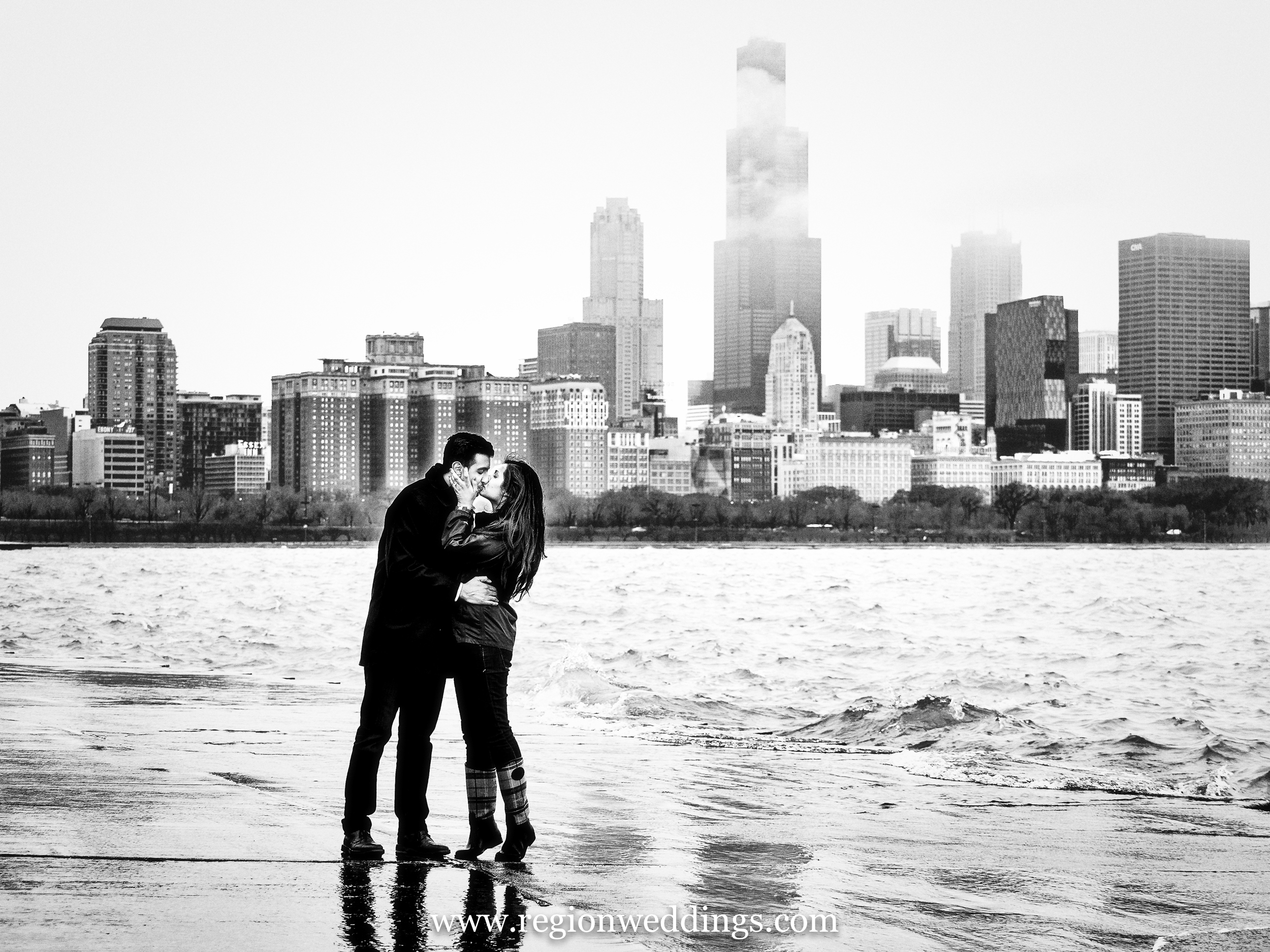 Black and white engagement photo on the Chicago lakefront.
