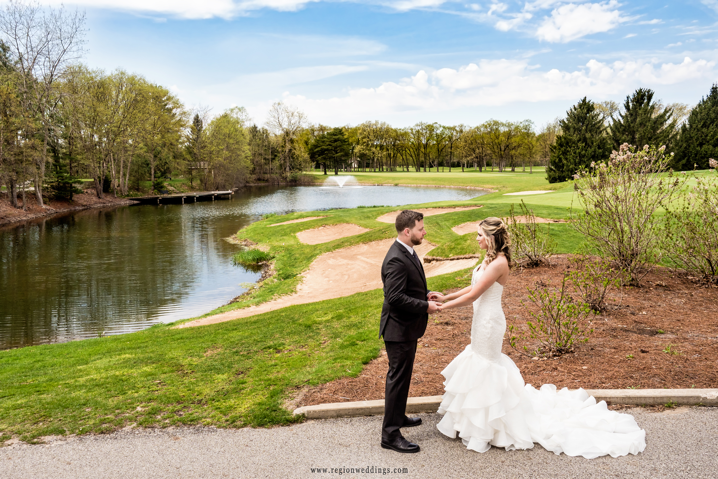 Bride and groom overlooking the lake at Sandy Pines Golf Course.
