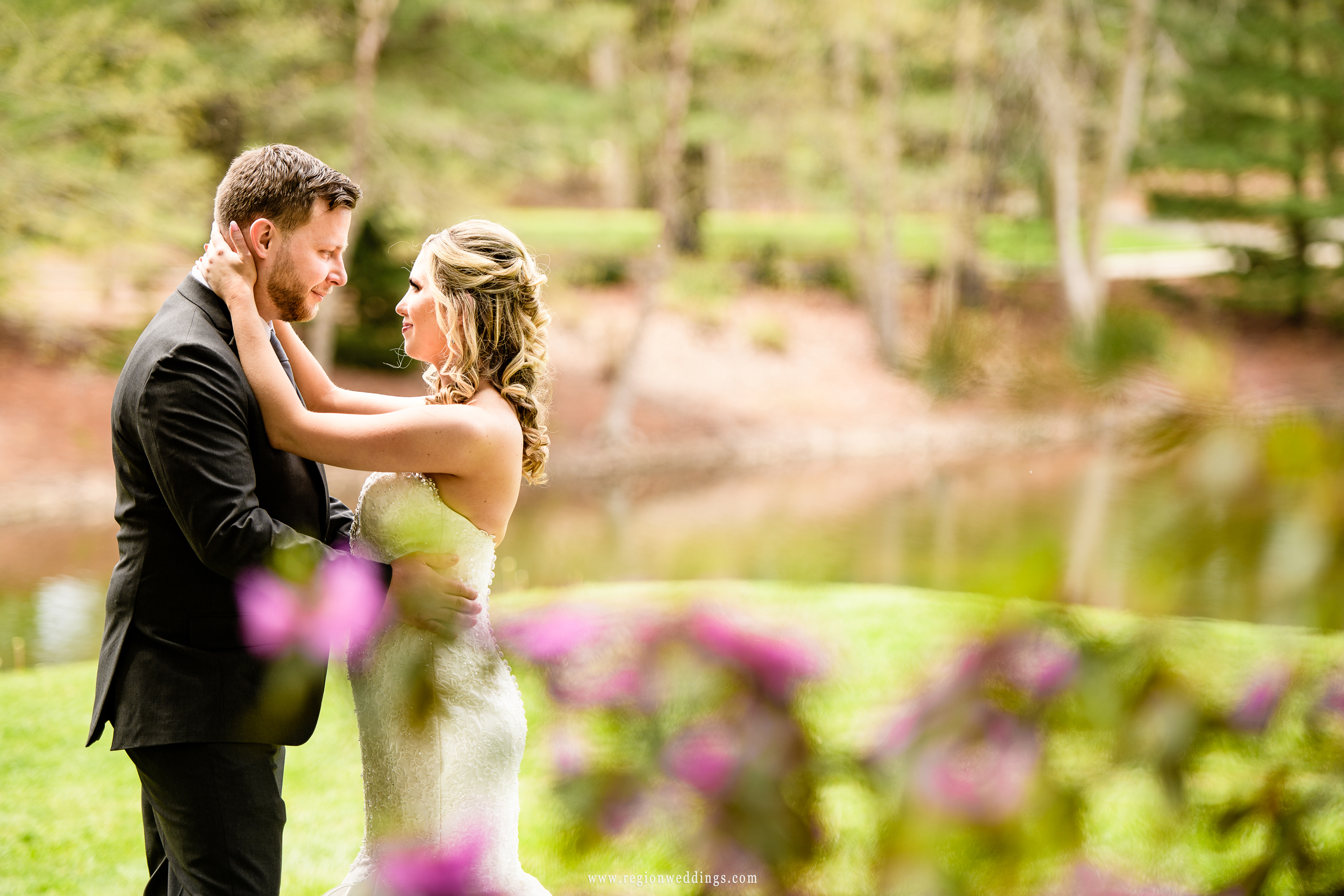 A loving moment between newlyweds at The Pavilion at Sandy Pines.