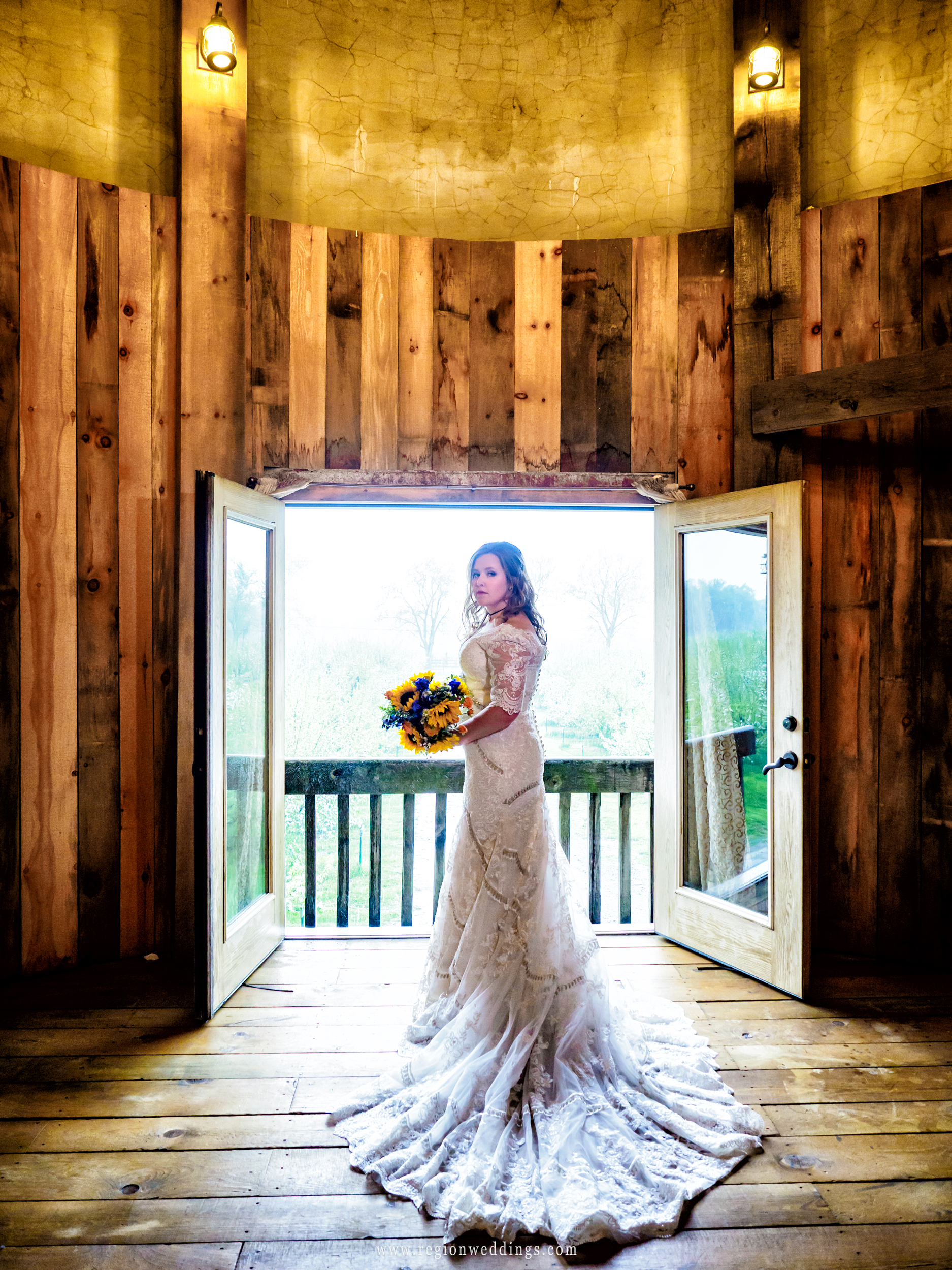 The bride inside the rustic silo bridal suite on her wedding day.