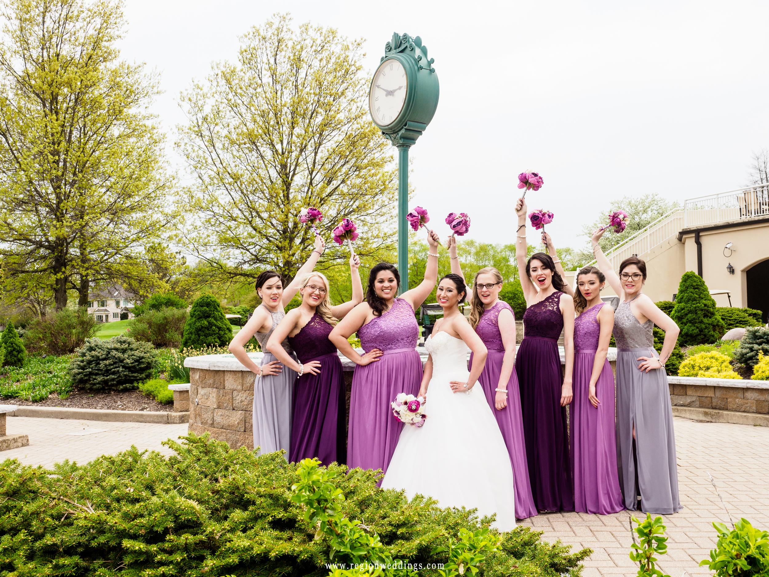 Bridesmaids cheer at the clock tower at Sand Creek.