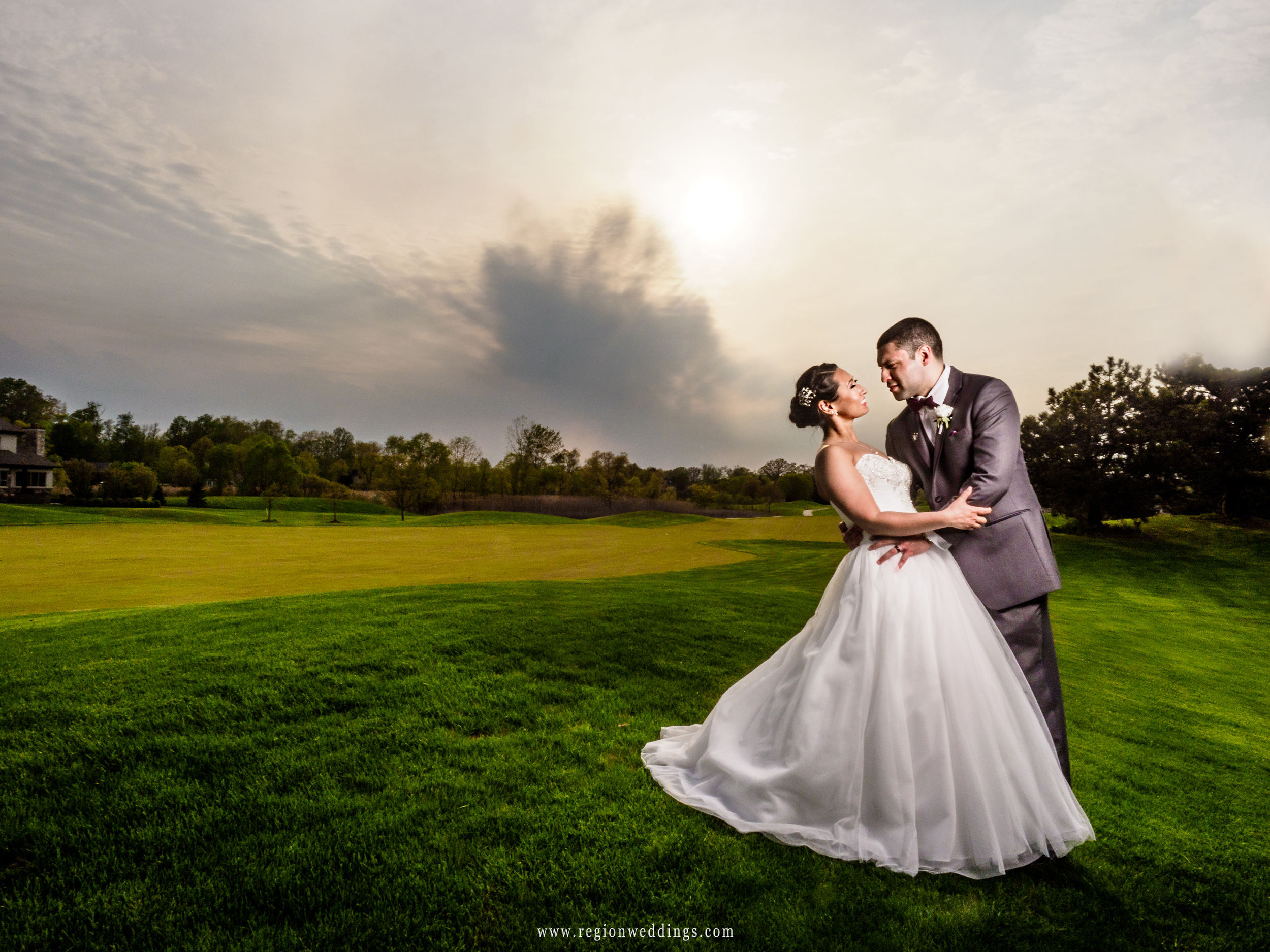 Bride and groom on the hills of Sand Creek golf course.