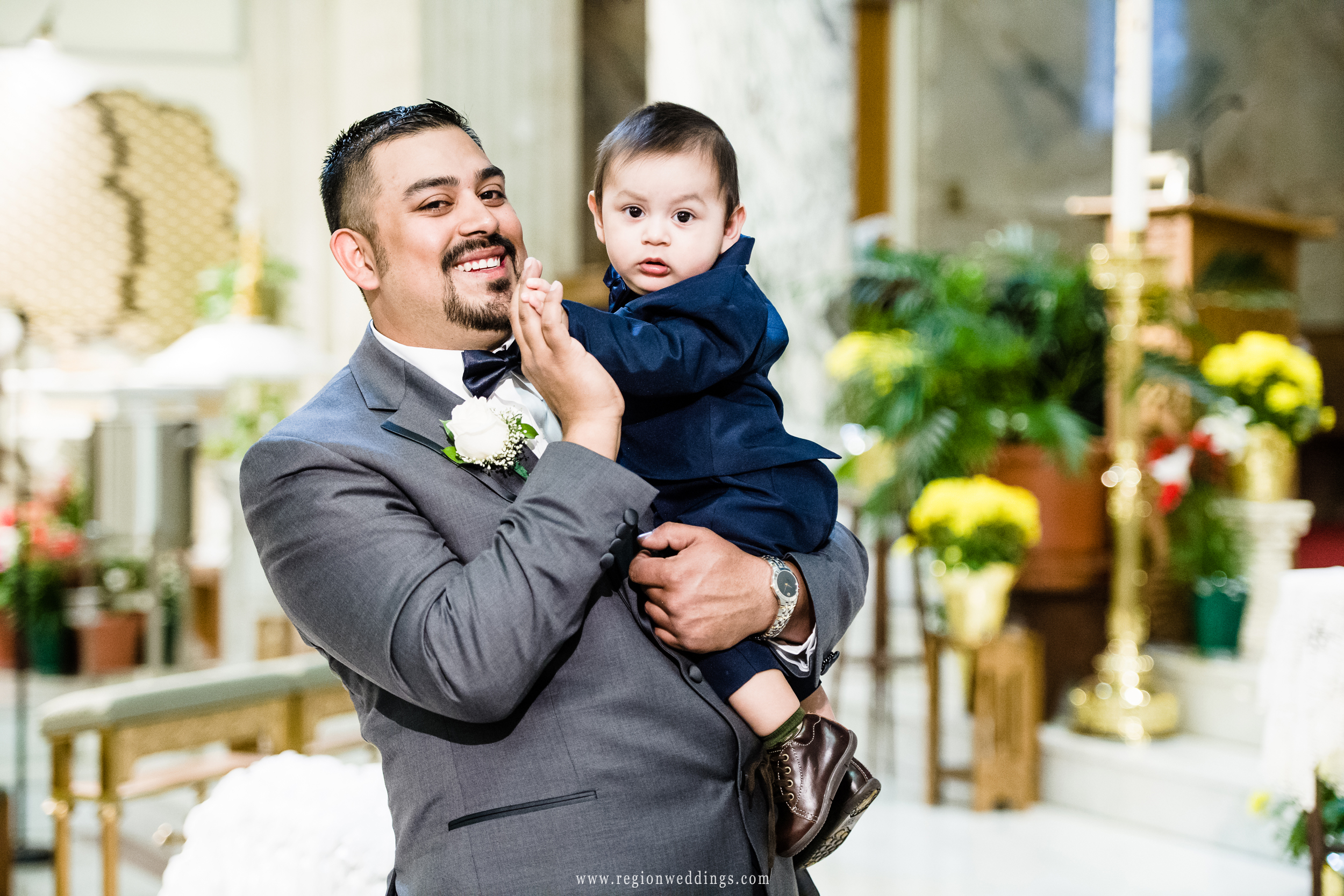 The groom with his son at church.