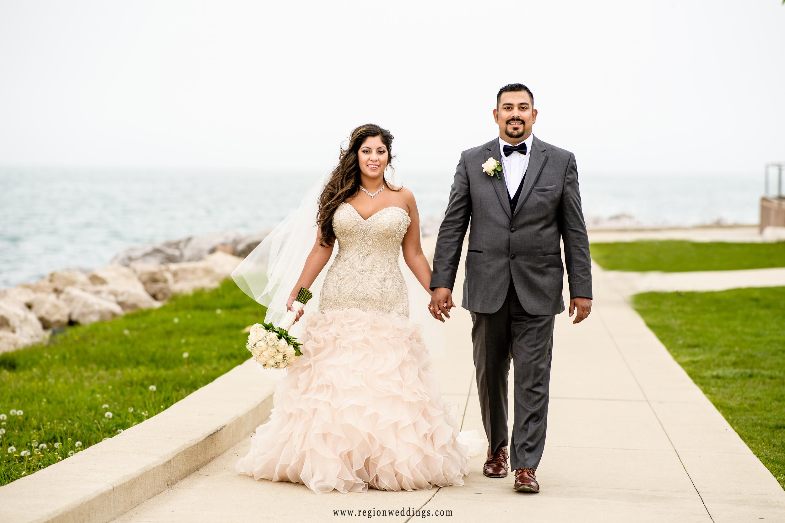 Romantic walk along Lake michigan for the bride and groom.