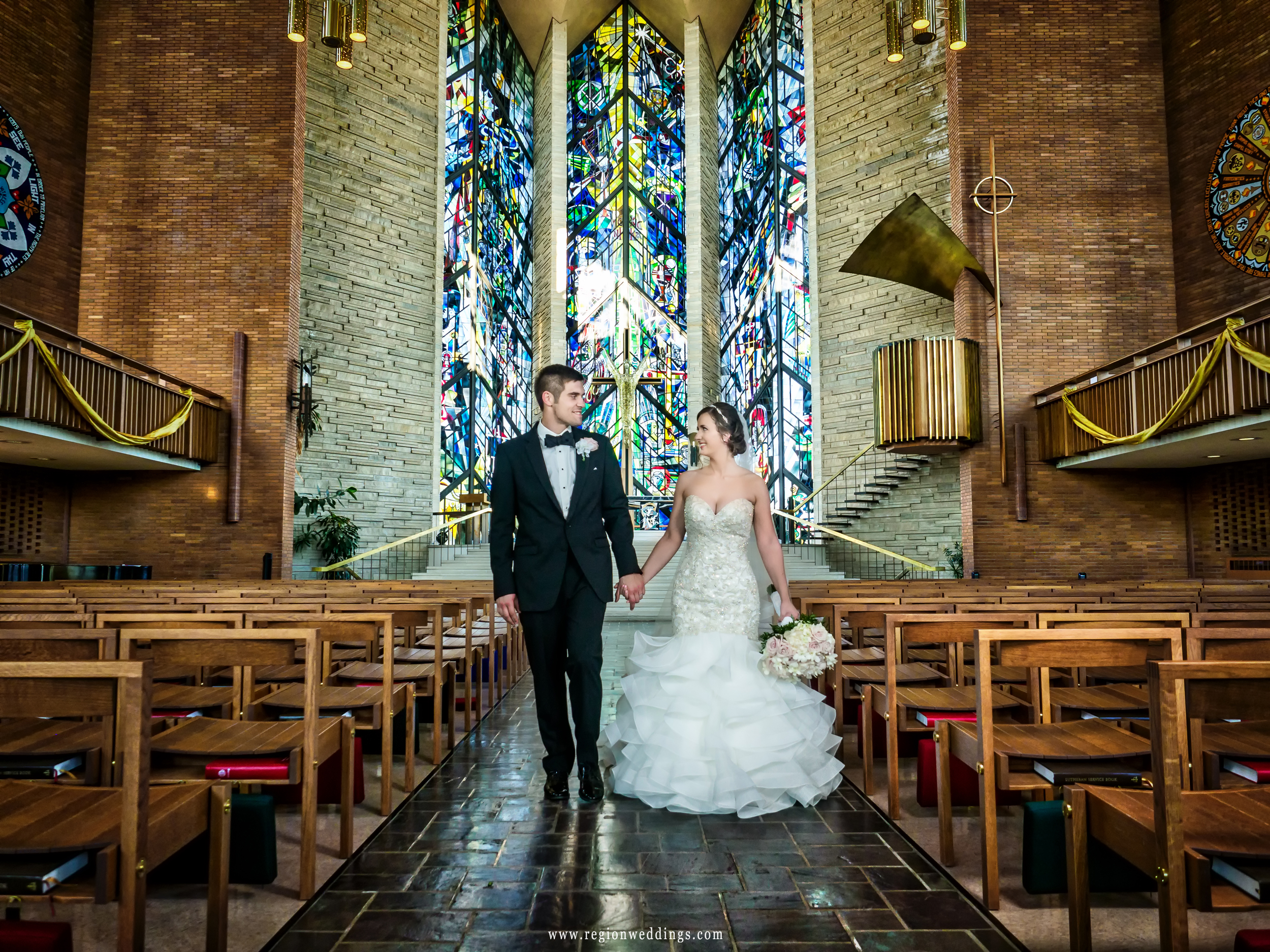 Bride and groom walk down the aisle at Chapel of the Resurrection.