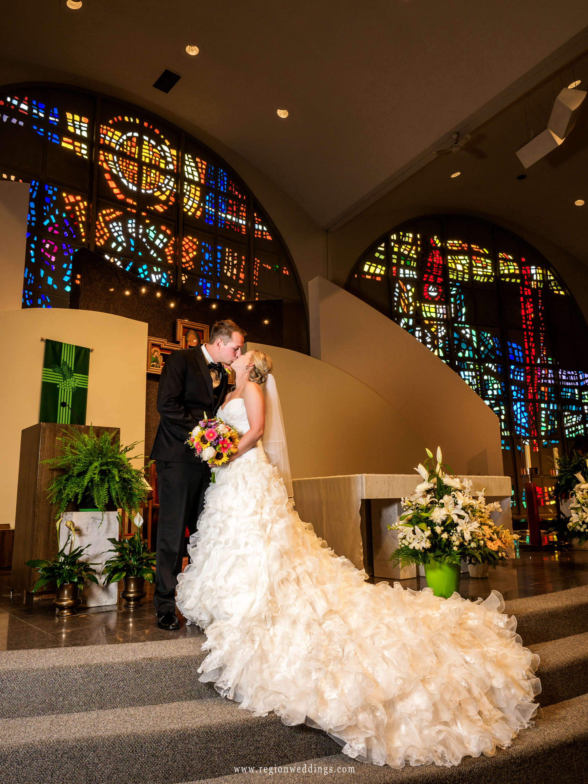 Bride and groom on the altar of St. Paul.