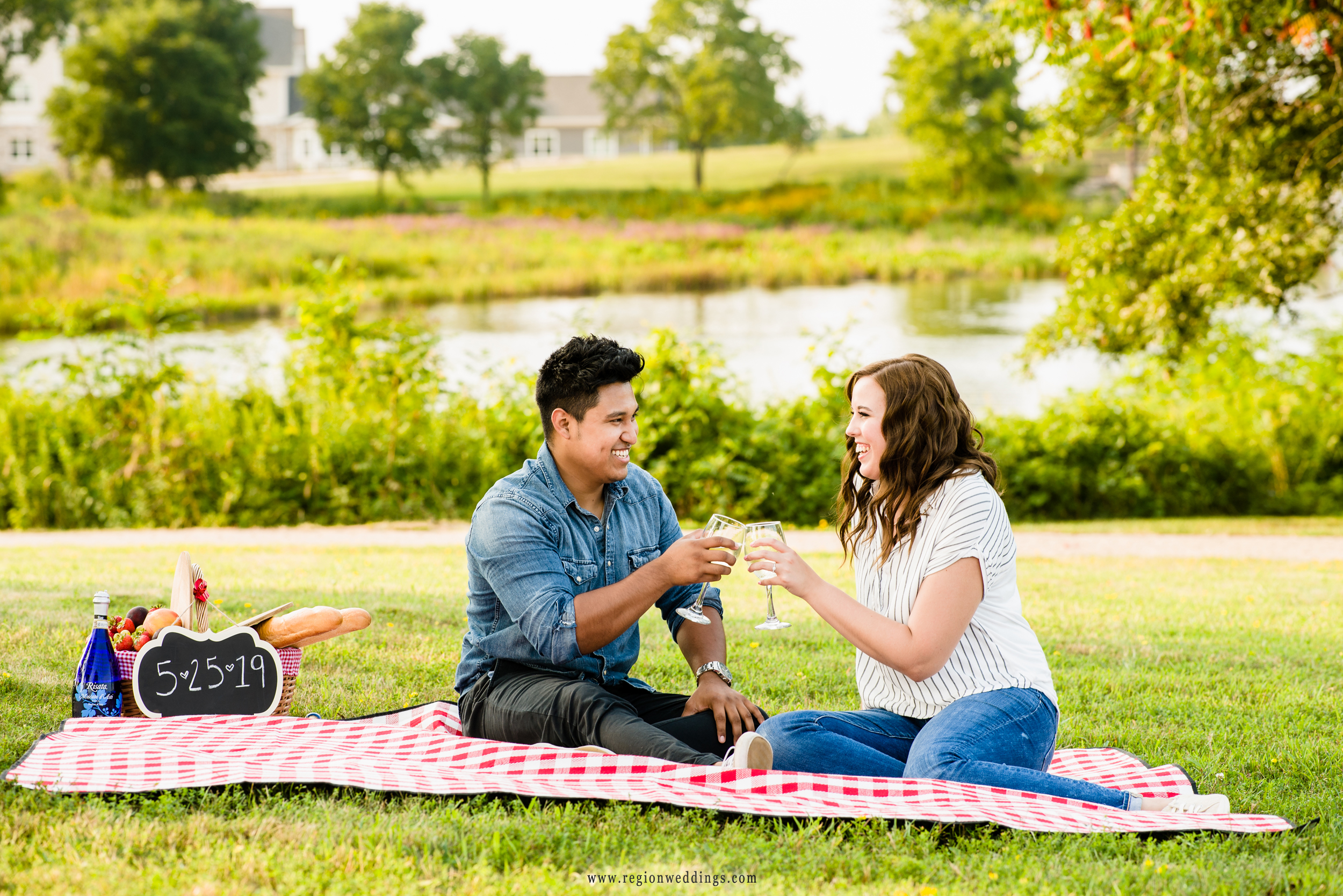 A young couple enjoys wine during their picnic at Coffee Creek Park.
