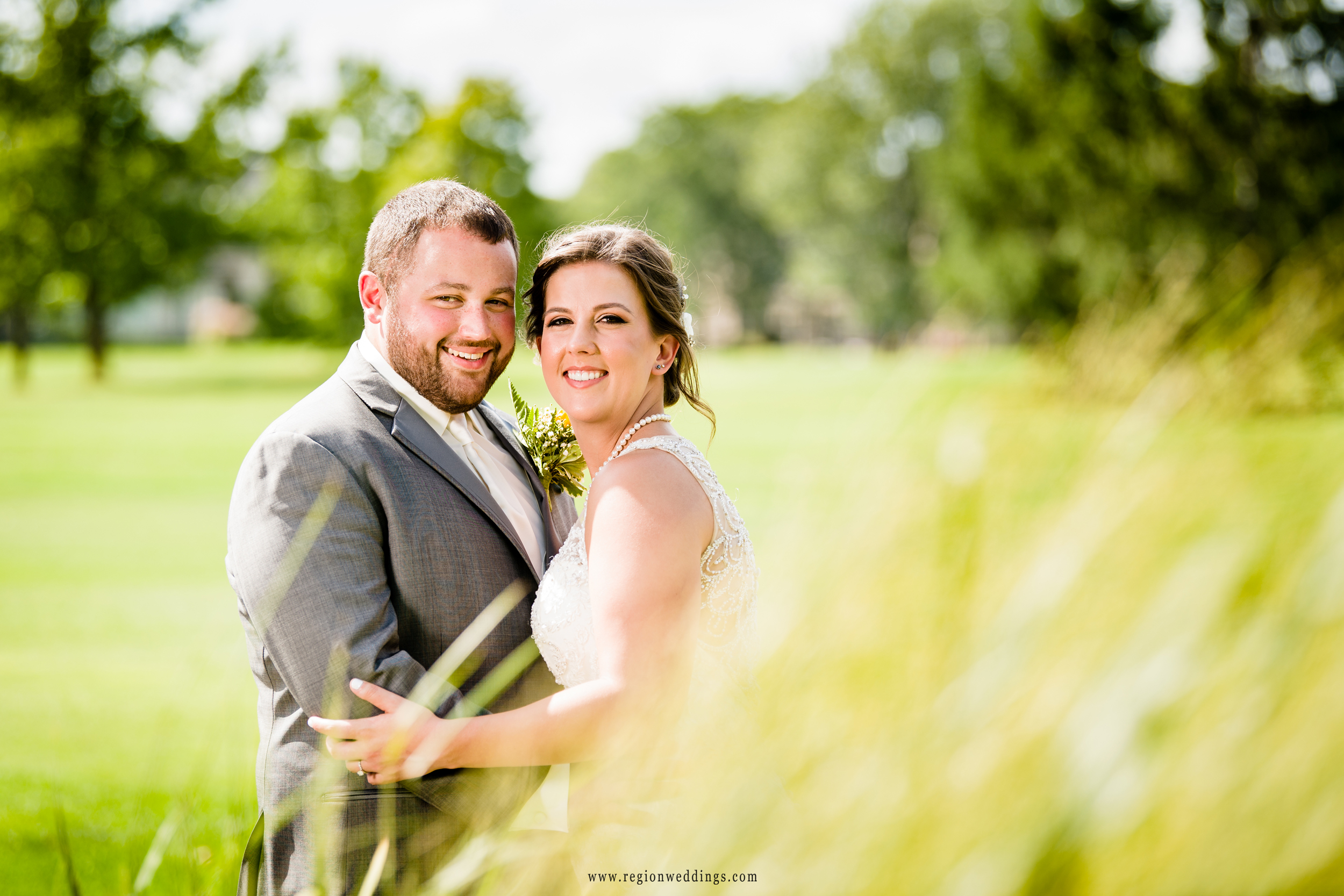Portrait on the golf course for the bride and groom.