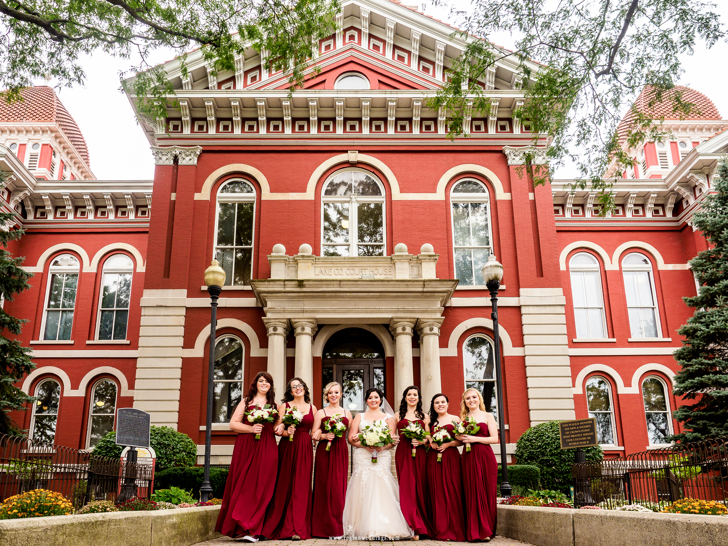 Bride and bridesmaids in front of the Old Crown Point Courthouse.
