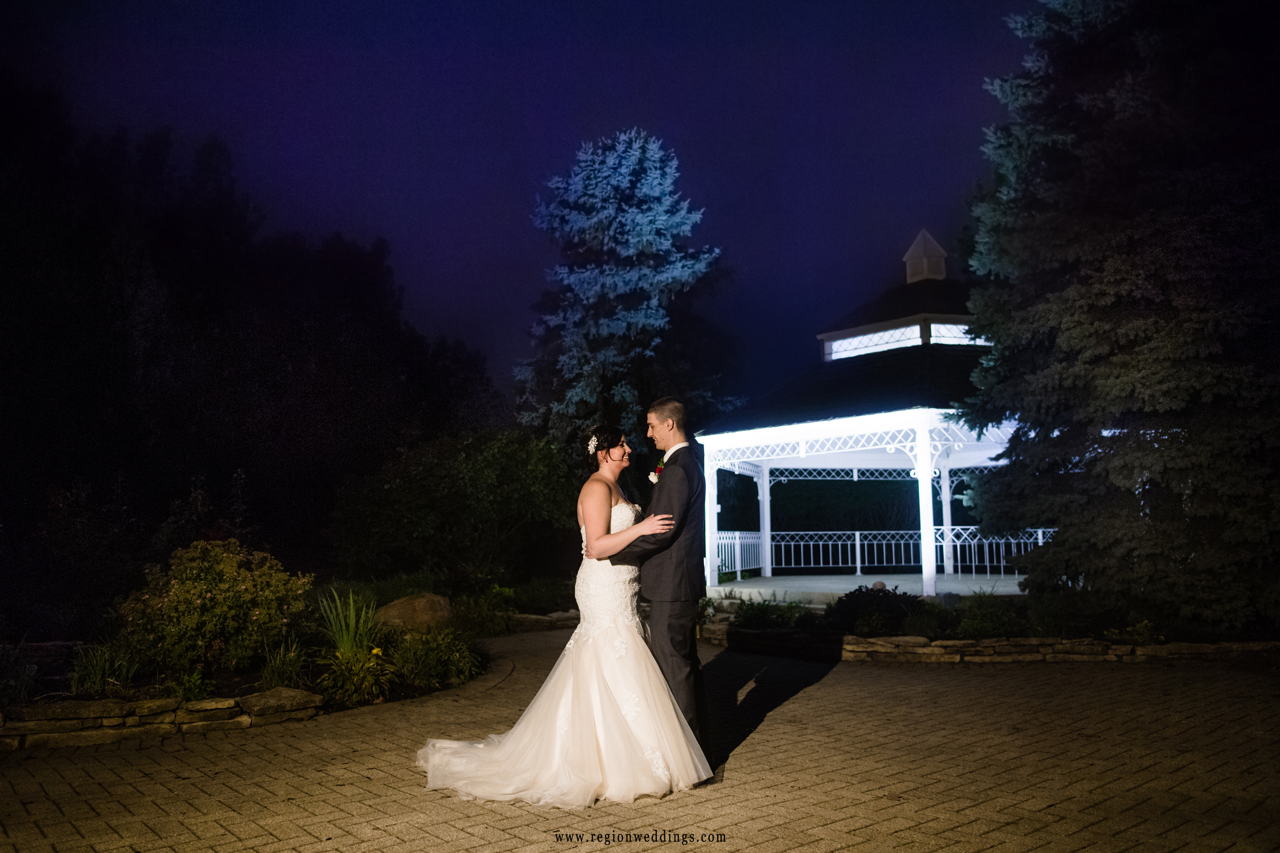 Night dance with the bride and groom outside by the gazebo.