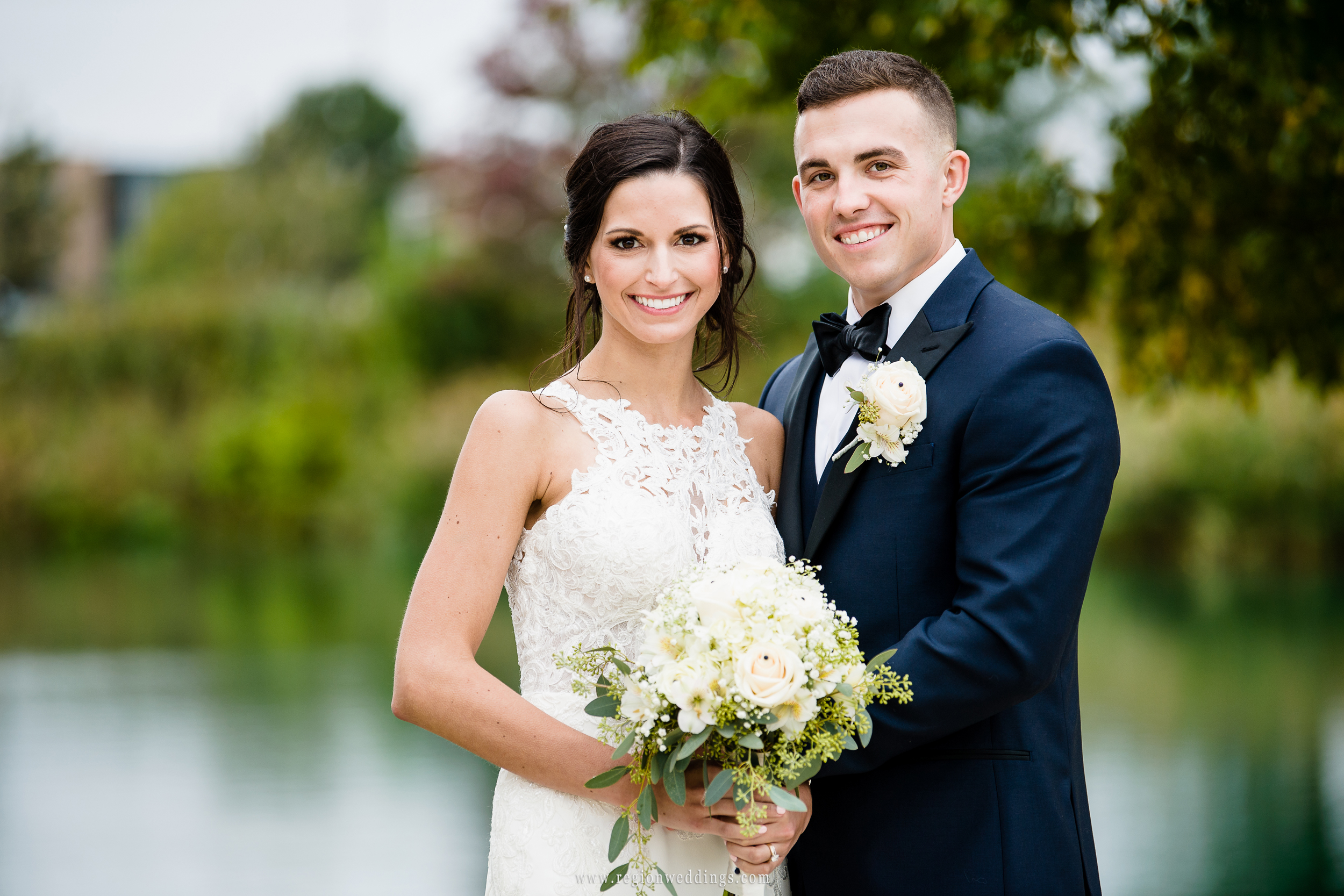 A lakeside portrait of the bride and groom.