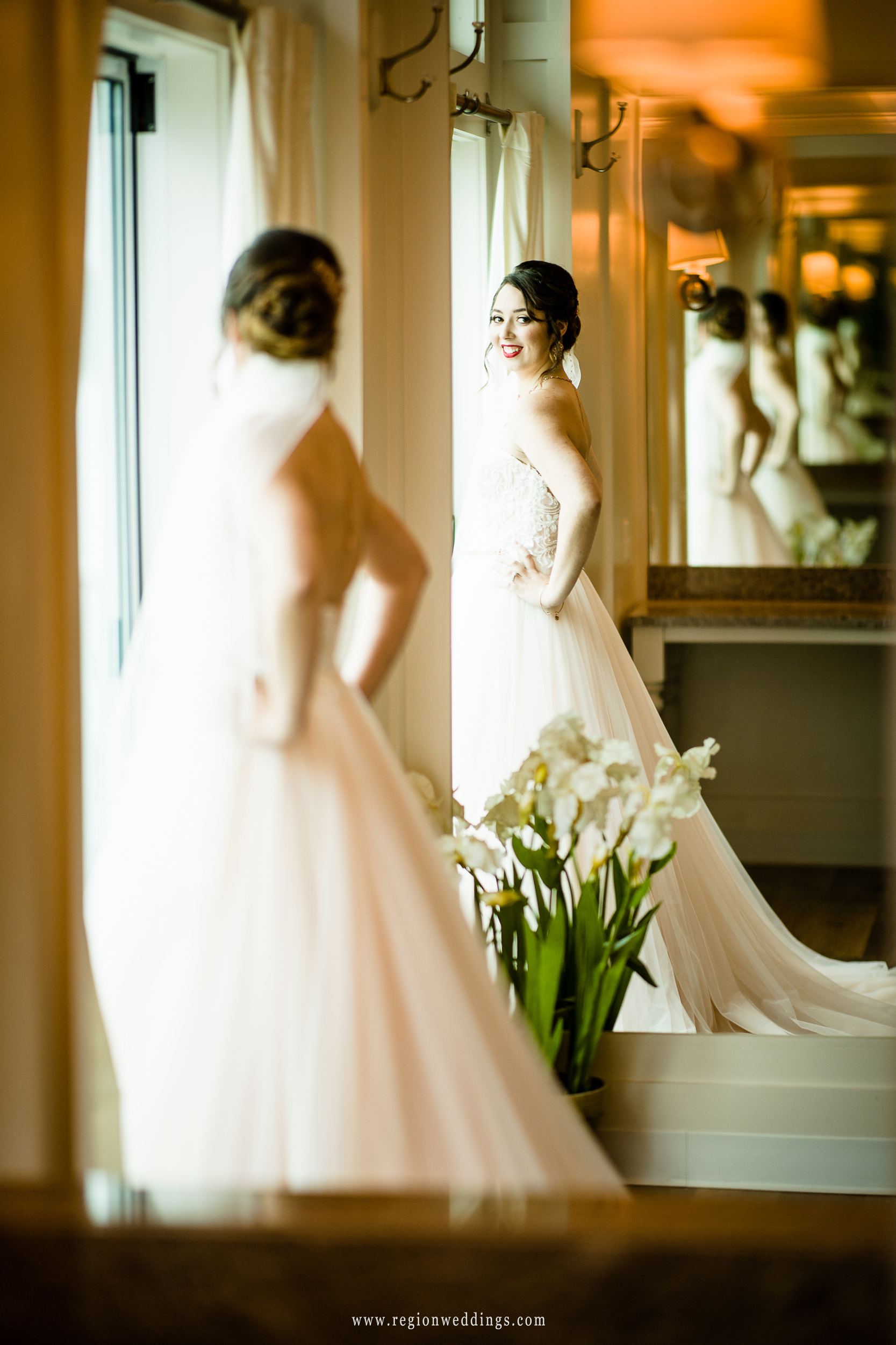 Bride in the mirror in the bridal suite at Lighthouse Restaurant.
