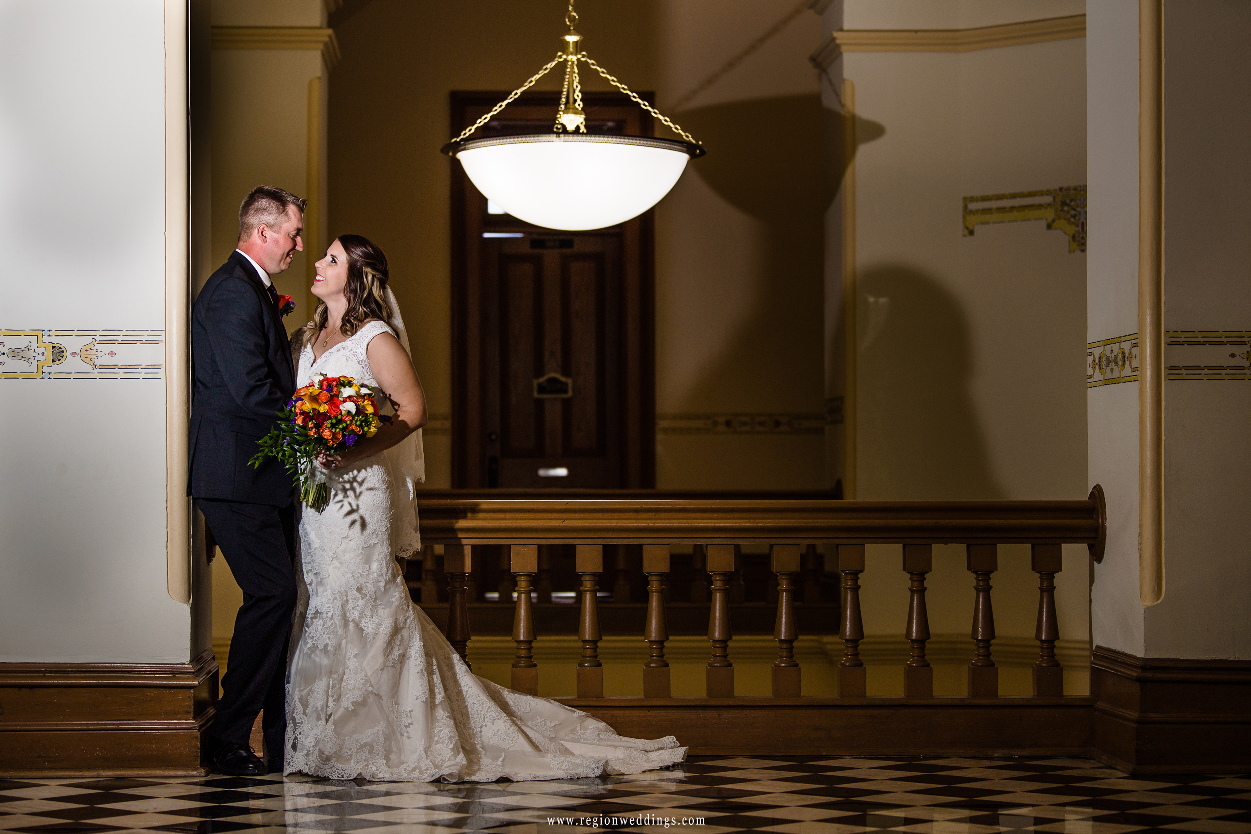 Bride and groom on the historic third floor of the Crown Point Courthouse.