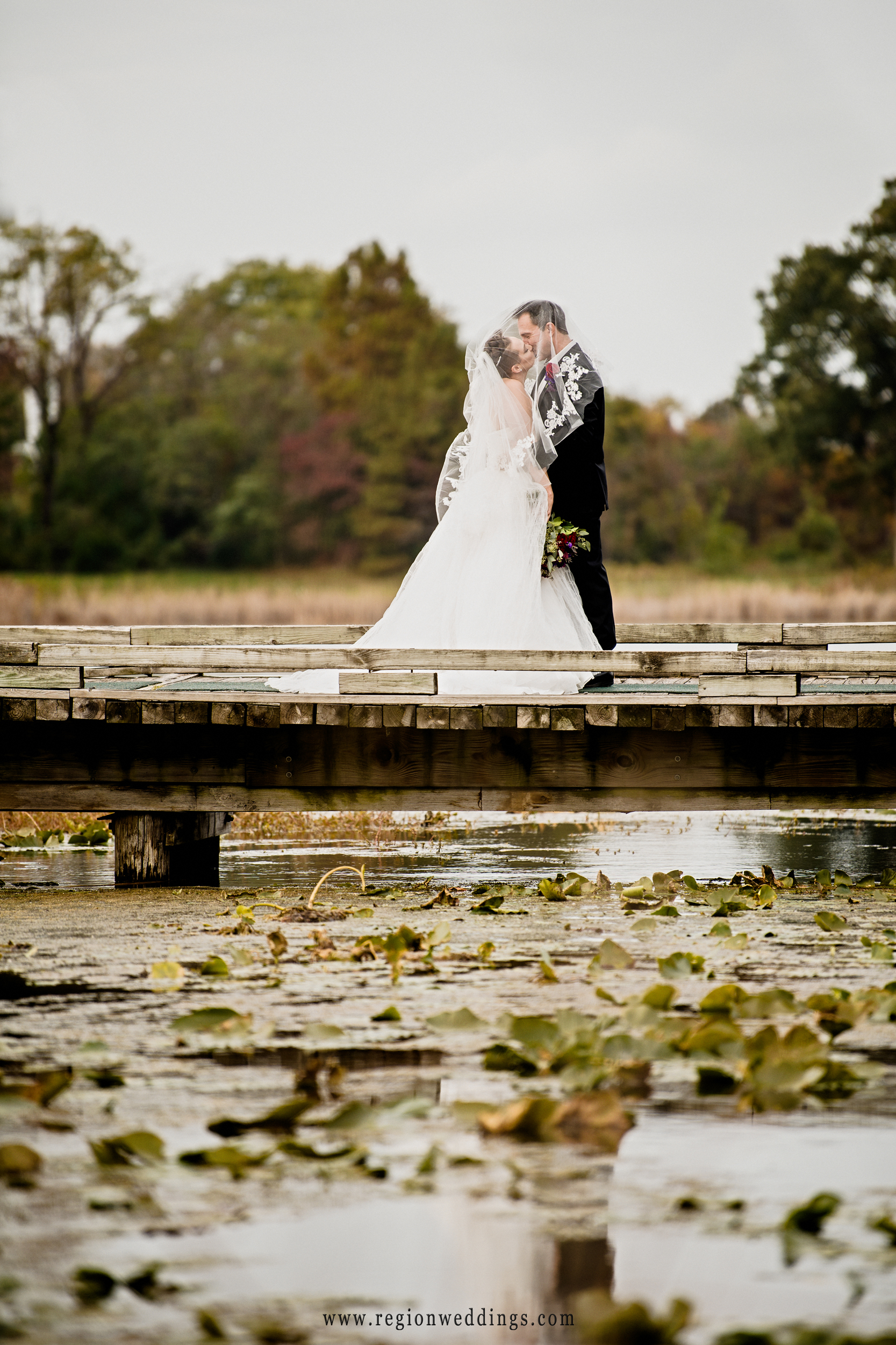 Under the veil kiss at Sand Creek Country Club in Chesterton, Indiana.