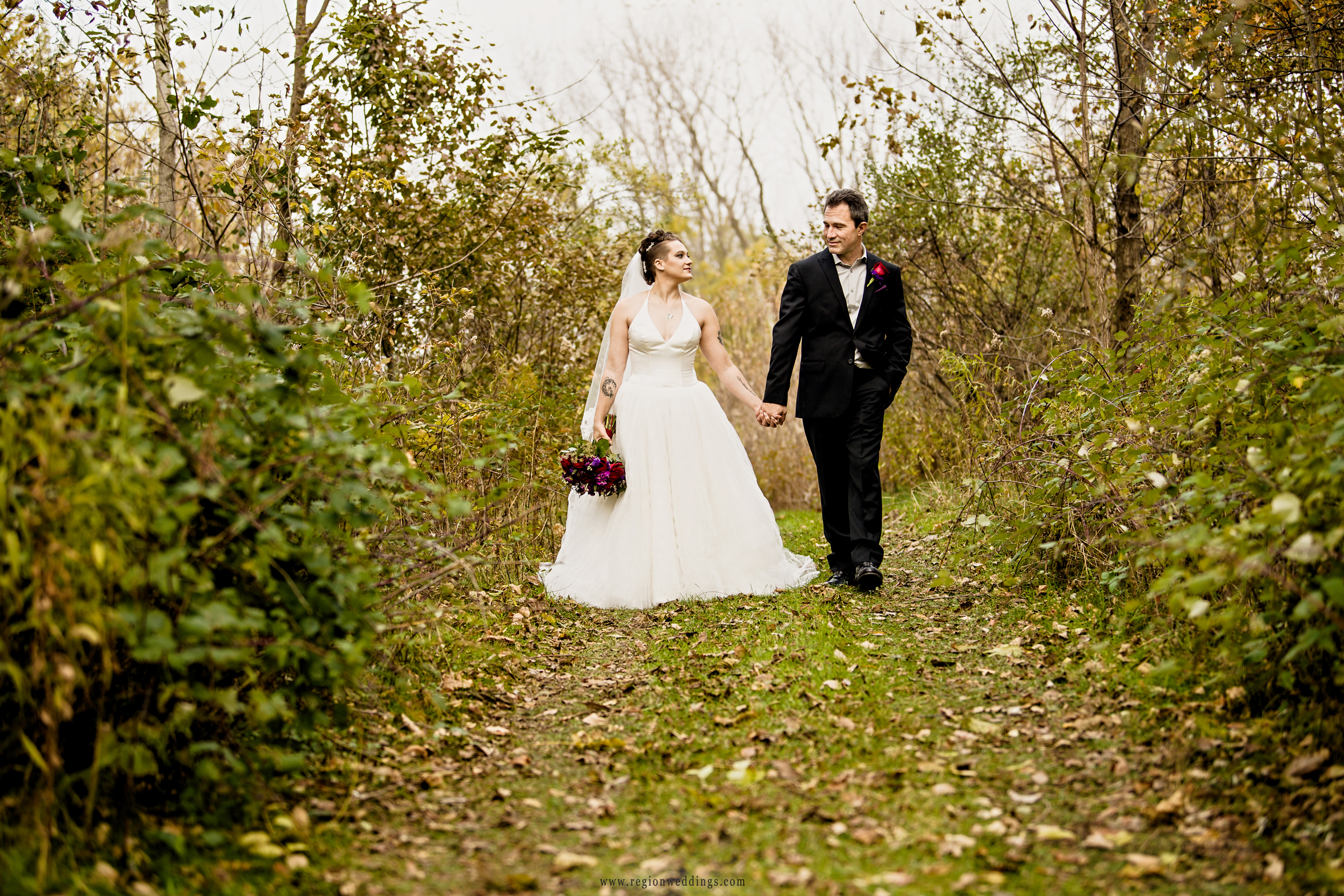 Autumn walk for the bride and groom at Sand Creek Country Club.